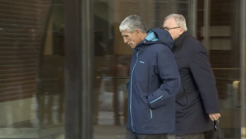 William Singer walks out of federal court.