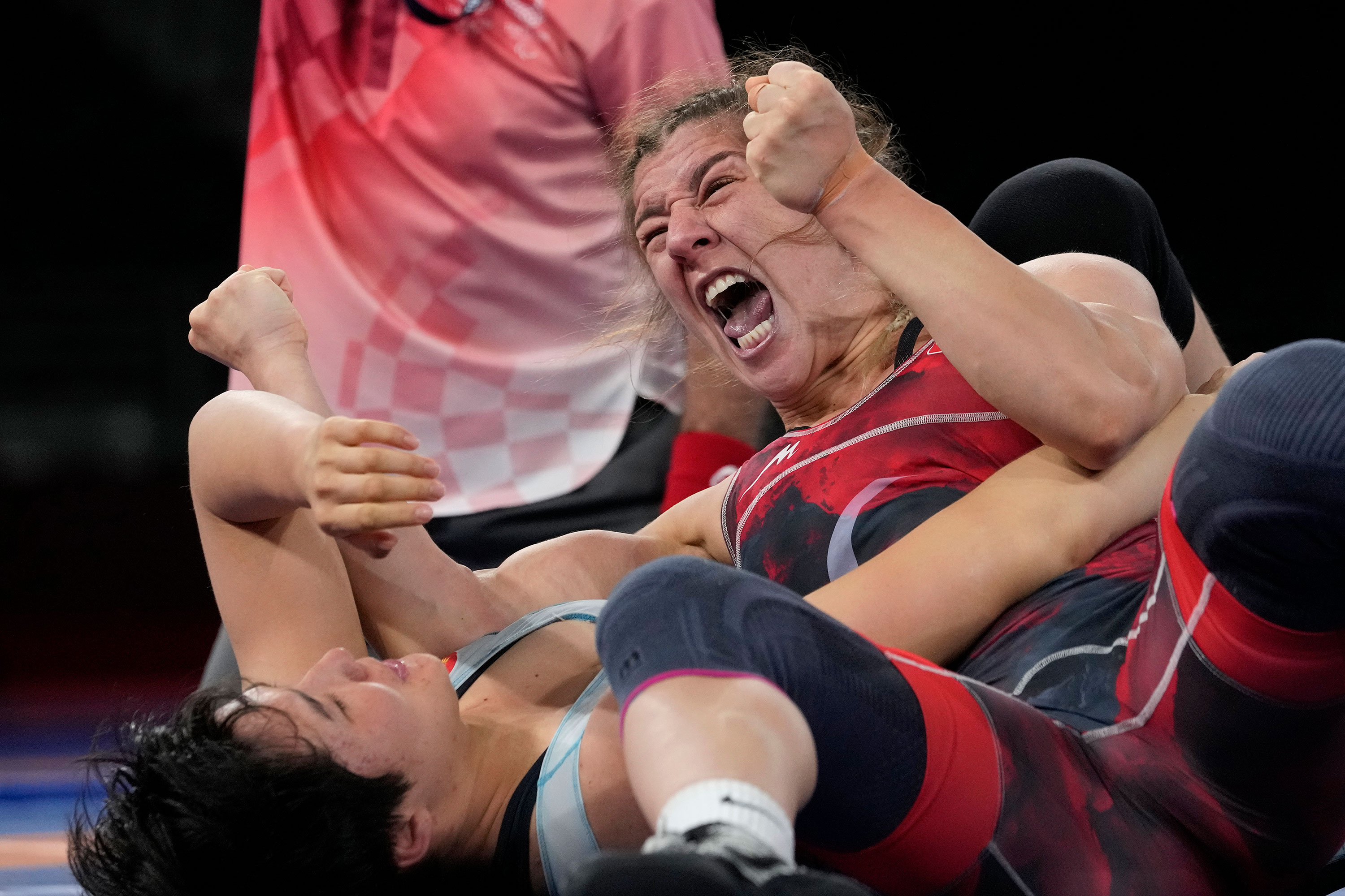 Turkey's Yasemin Adar celebrates after defeating Kyrgyzstan's Aiperi Medet Kyzy for the bronze in the 76kg freestyle wrestling match on August 2.