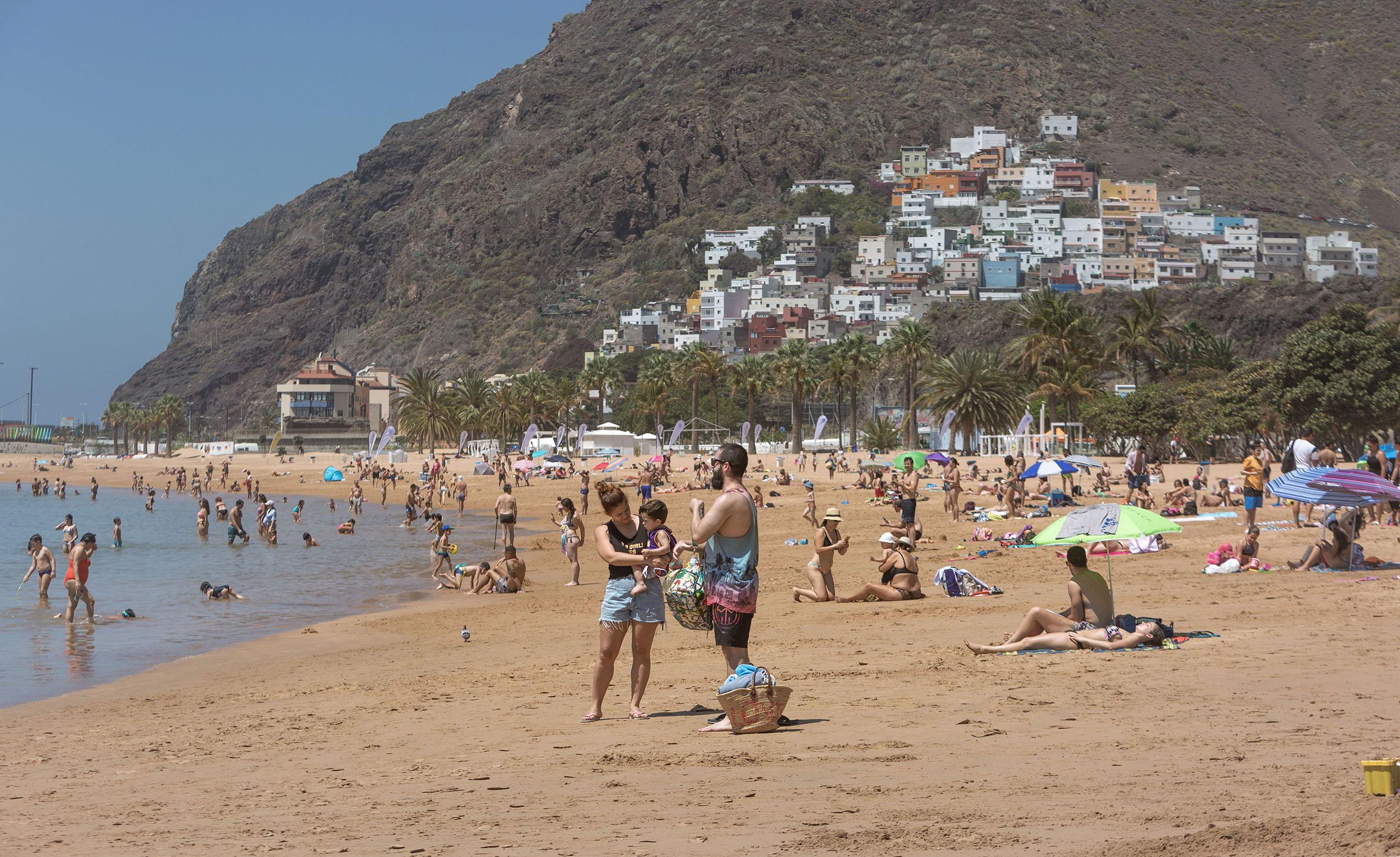 People sunbathe on Las Teresitas beach in the Spanish Canary Island of Tenerife, on Sunday, May 25.