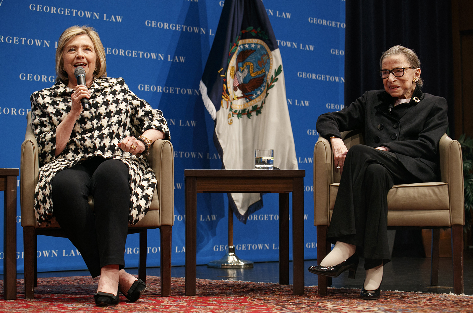Supreme Court Justice Ruth Bader Ginsburg, right, listens as former Secretary of State Hillary Clinton speaks on Wednesday, October 30, 2019, in Washington.