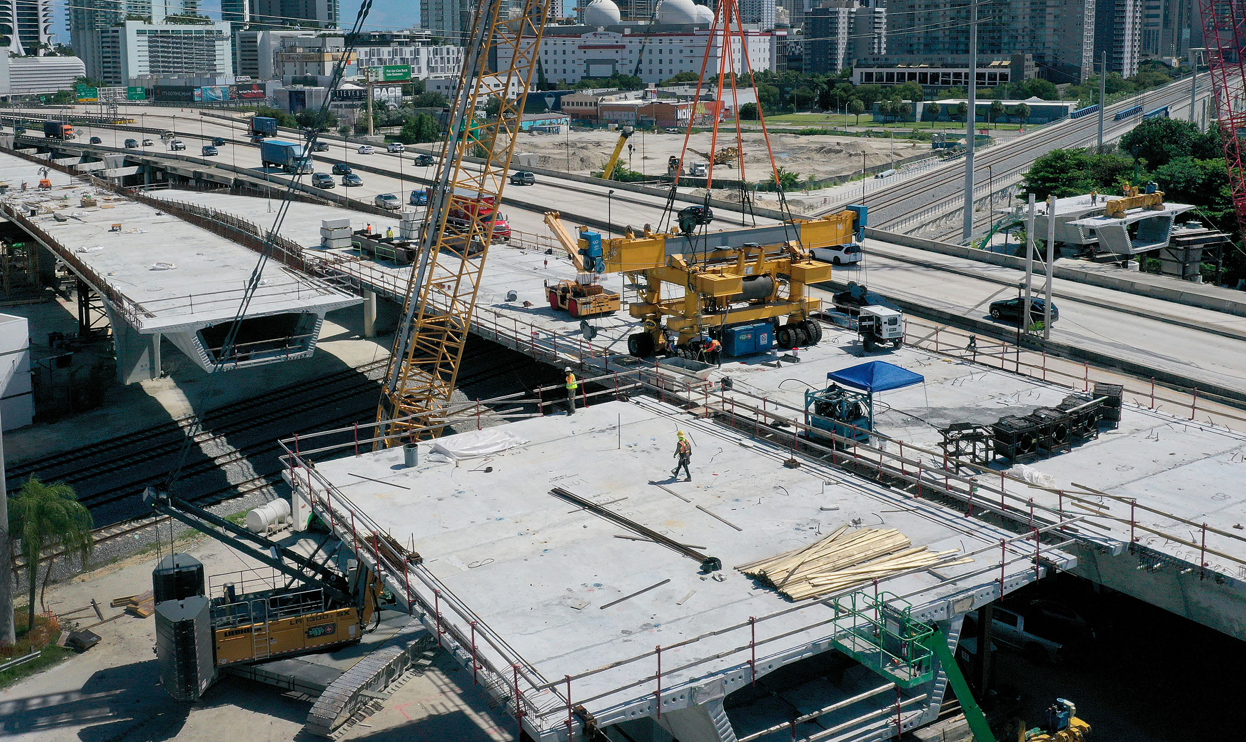 Construction workers build a bridge in Miami, Florida, on September 27.