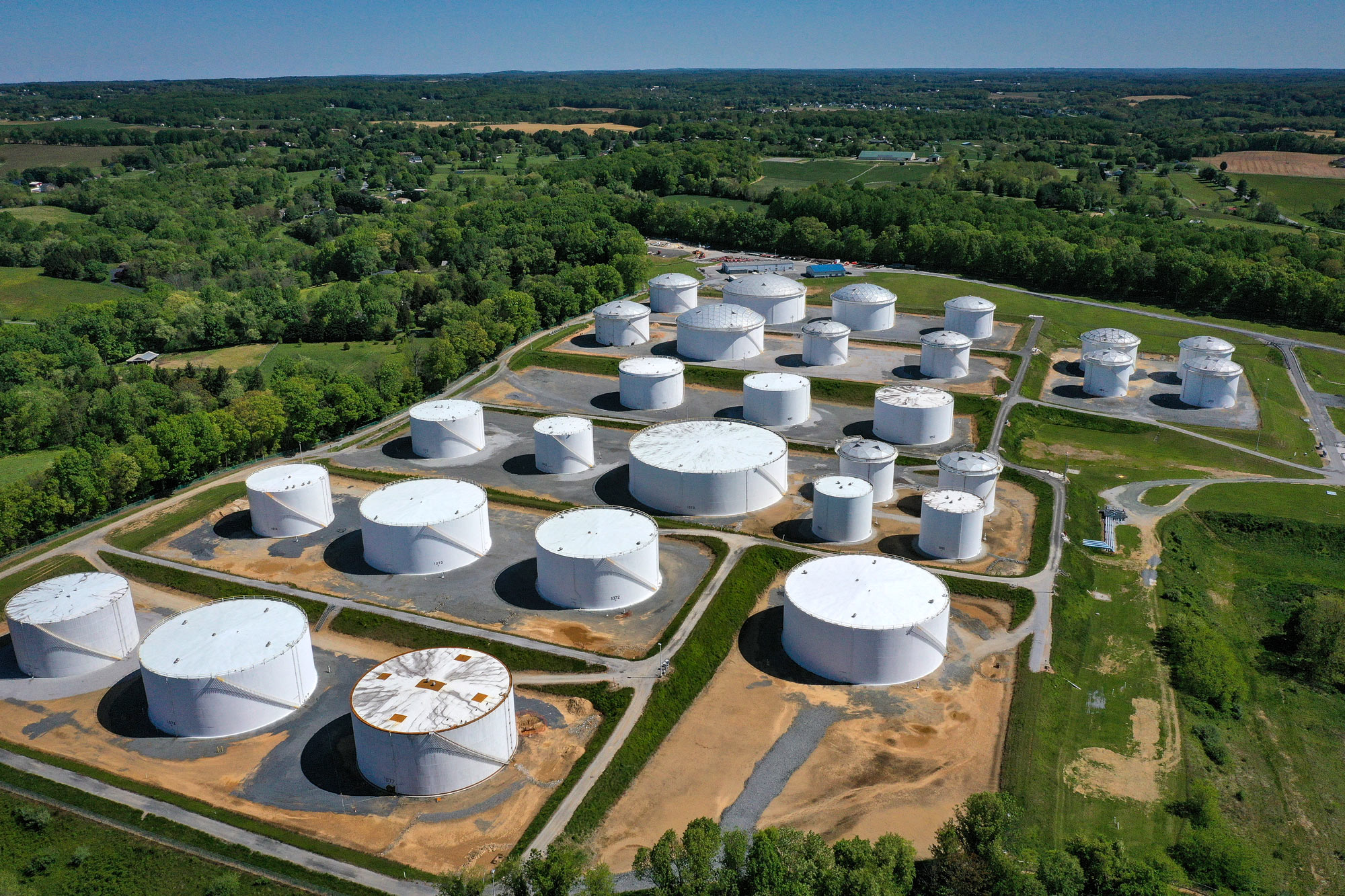 Fuel holding tanks are seen at Colonial Pipeline's Dorsey Junction Station on May 13 in Woodbine, Maryland.