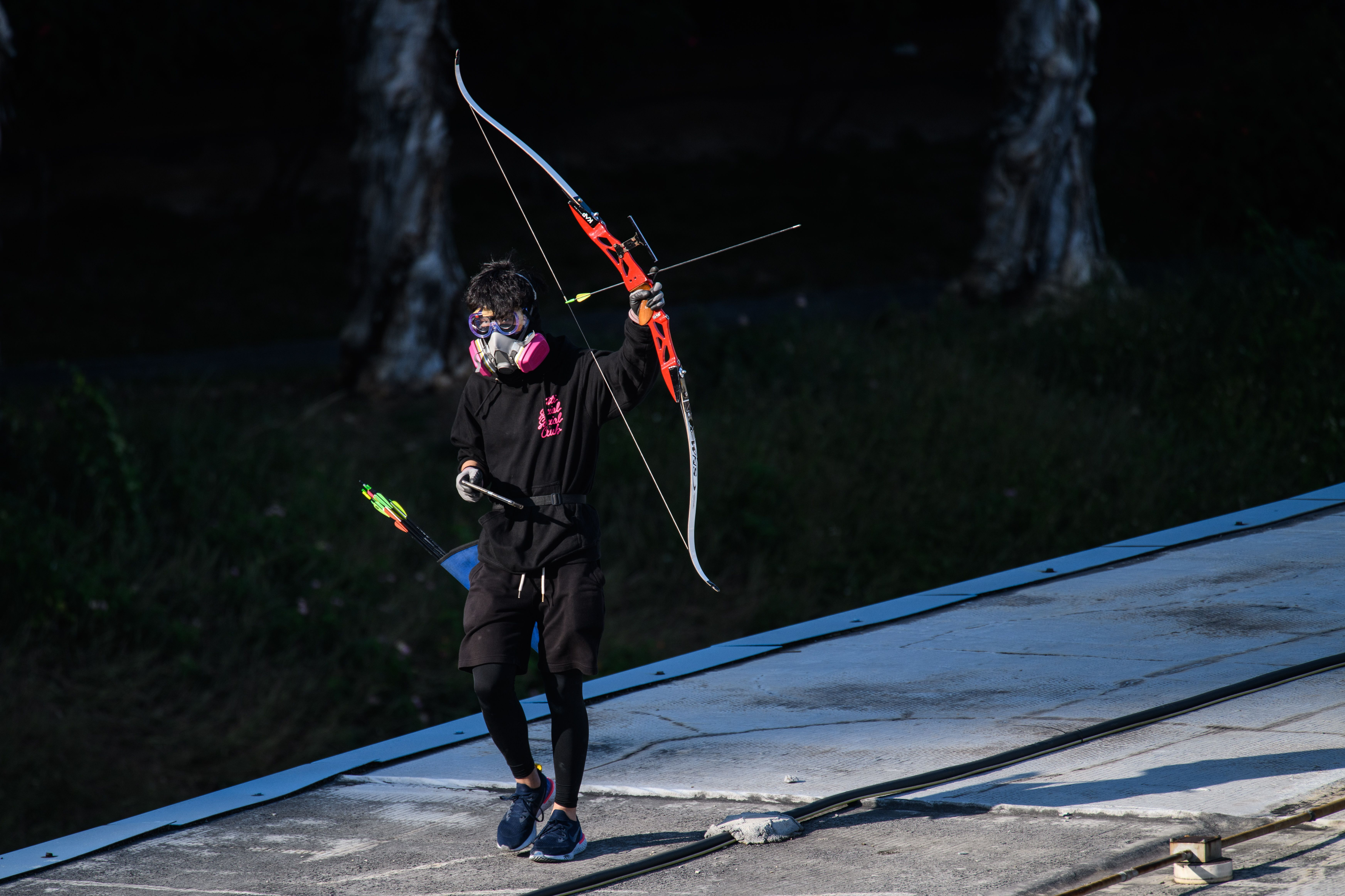 A protester walks with a bow and arrow near Hong Kong Polytechnic University on November 16.