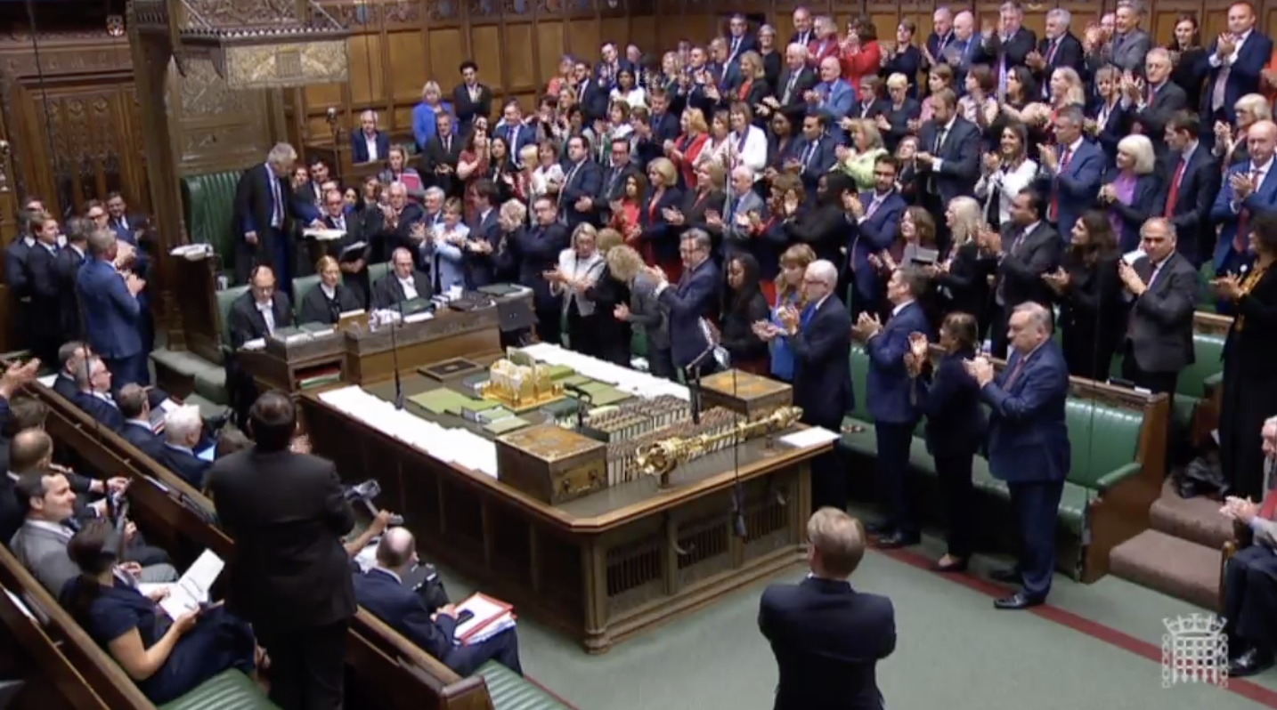 Lawmakers in the House of Commons give Speaker John Bercow a round of applause.