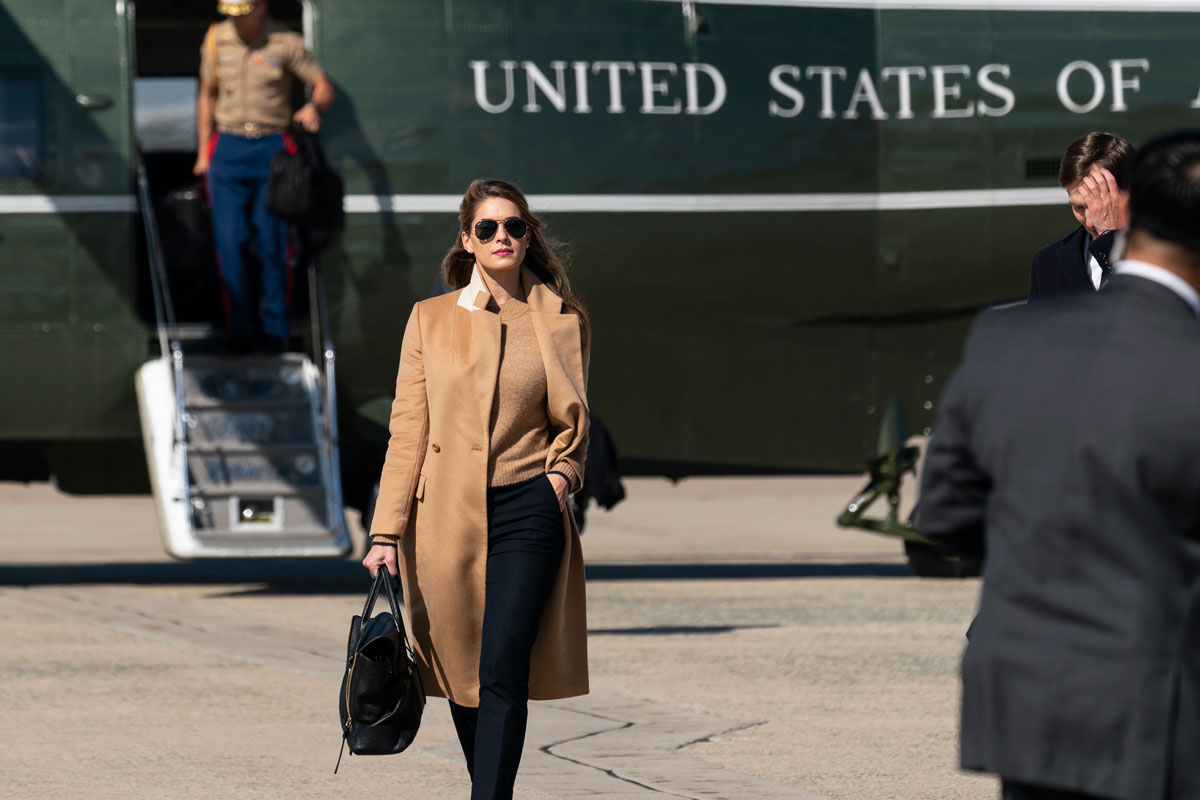 Counselor to the President Hope Hicks walks from Marine One at Andrews Air Force Base on Wednesday, September 30.