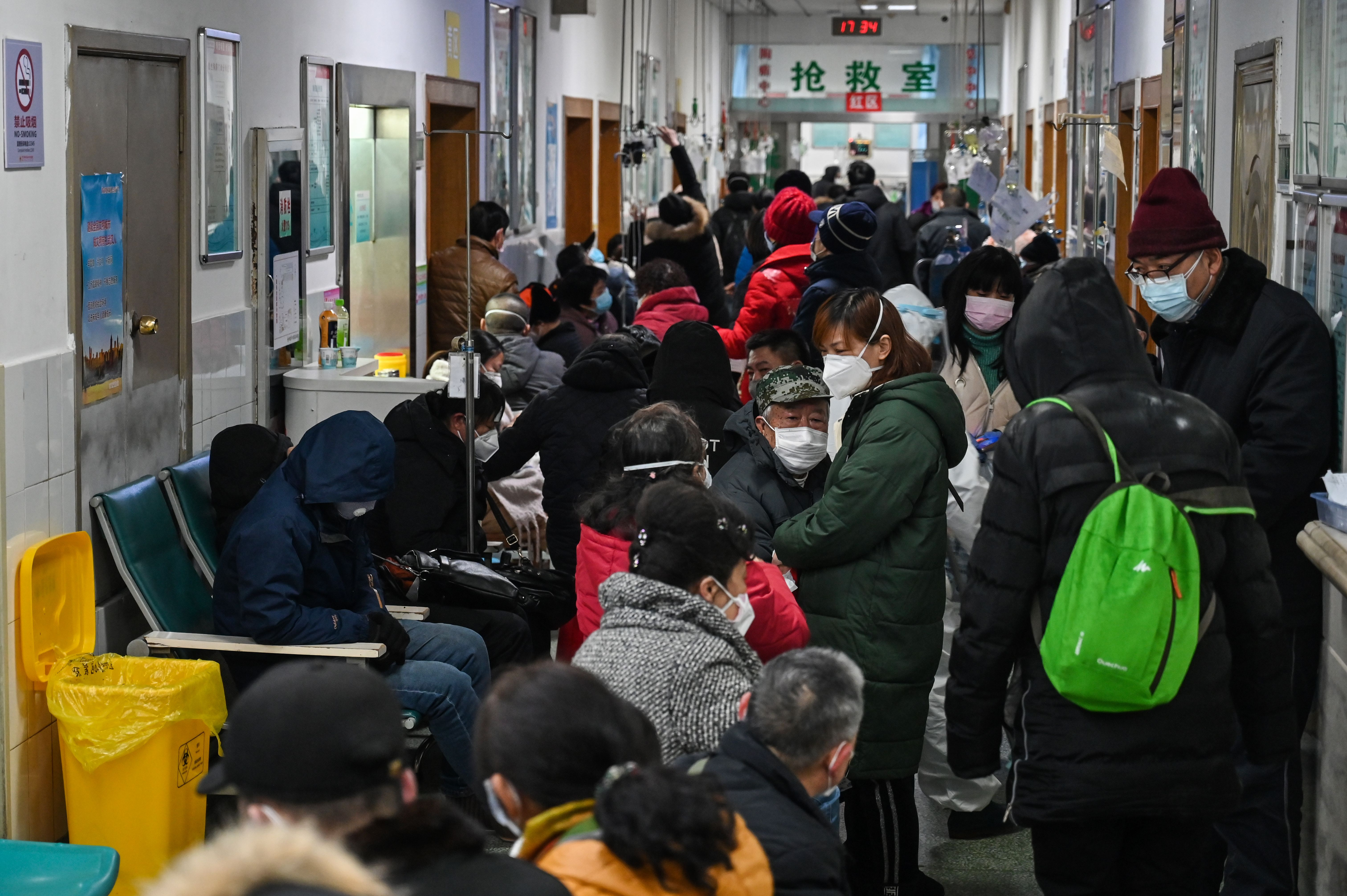 People wearing face masks wait for medical attention at Wuhan Red Cross Hospital in Wuhan on Saturday