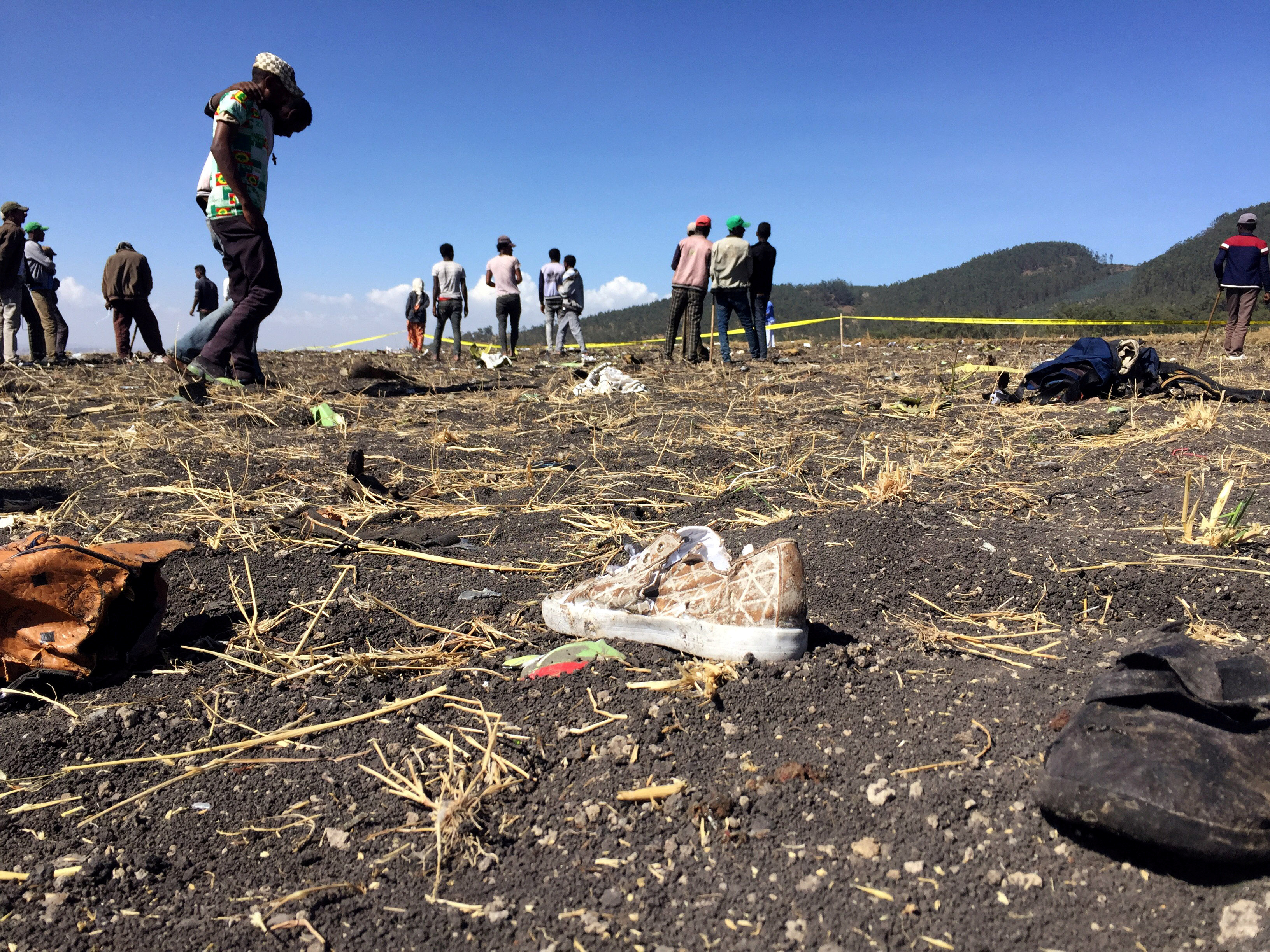 People walk at the scene of the Ethiopian Airlines Flight ET302 plane crash, near the town of Bishoftu, southeast of Addis Ababa, Ethiopia on March 10, 2019.