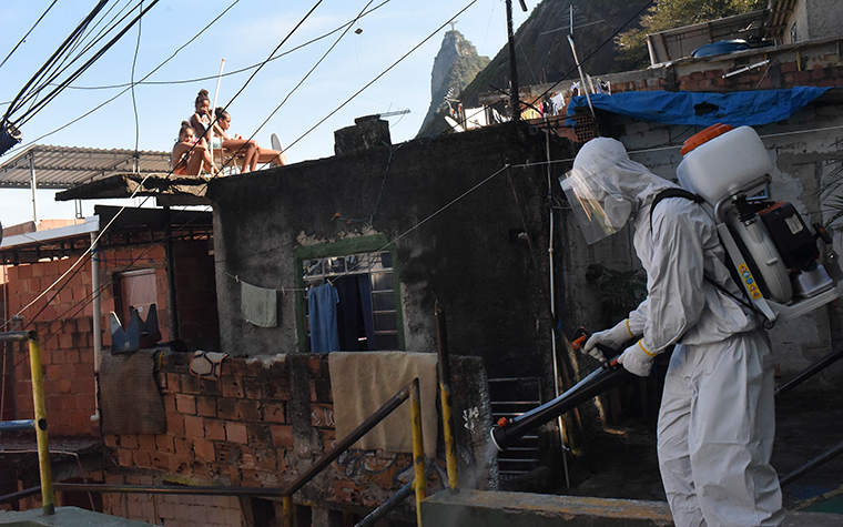 A coronavirus combat team disinfects the Morro Santa Marta favela, south of Rio de Janeiro on June 24.