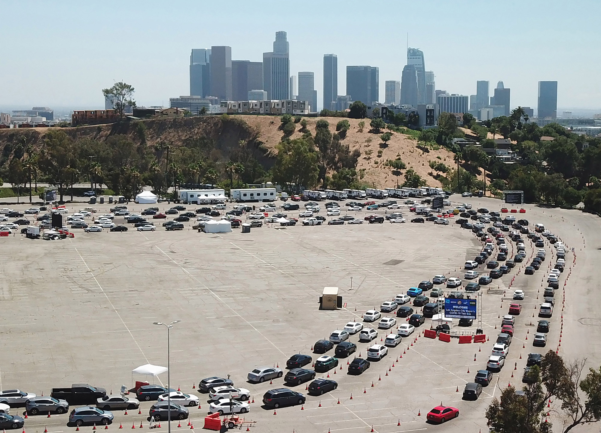 An aerial view shows a long line of cars at a COVID-19 testing site at Dodgers Stadium in Los Angeles on July 15.