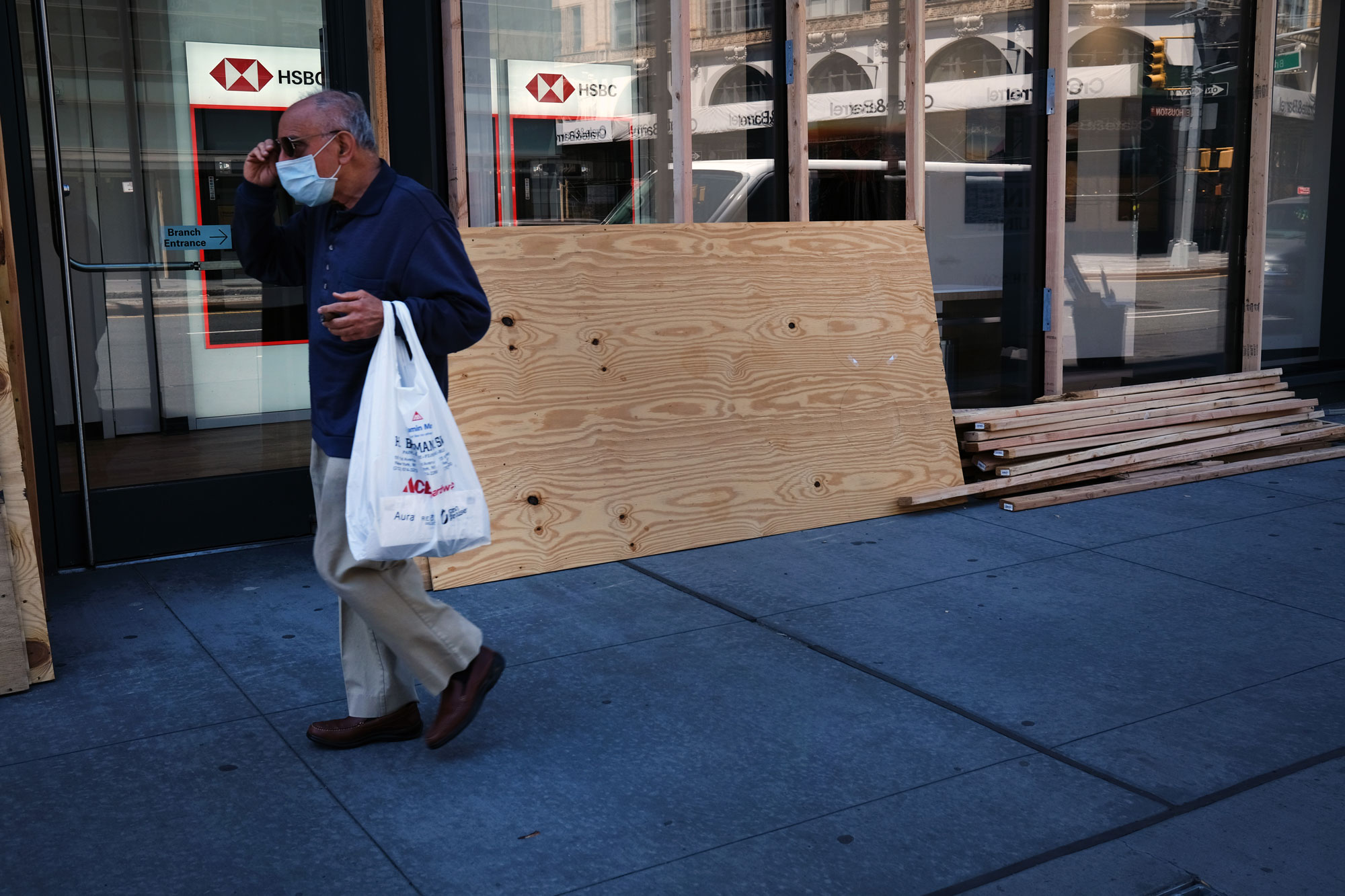 People walk through a central shopping district as stores prepare for gradual reopenings in the coming weeks on June 16 in New York.