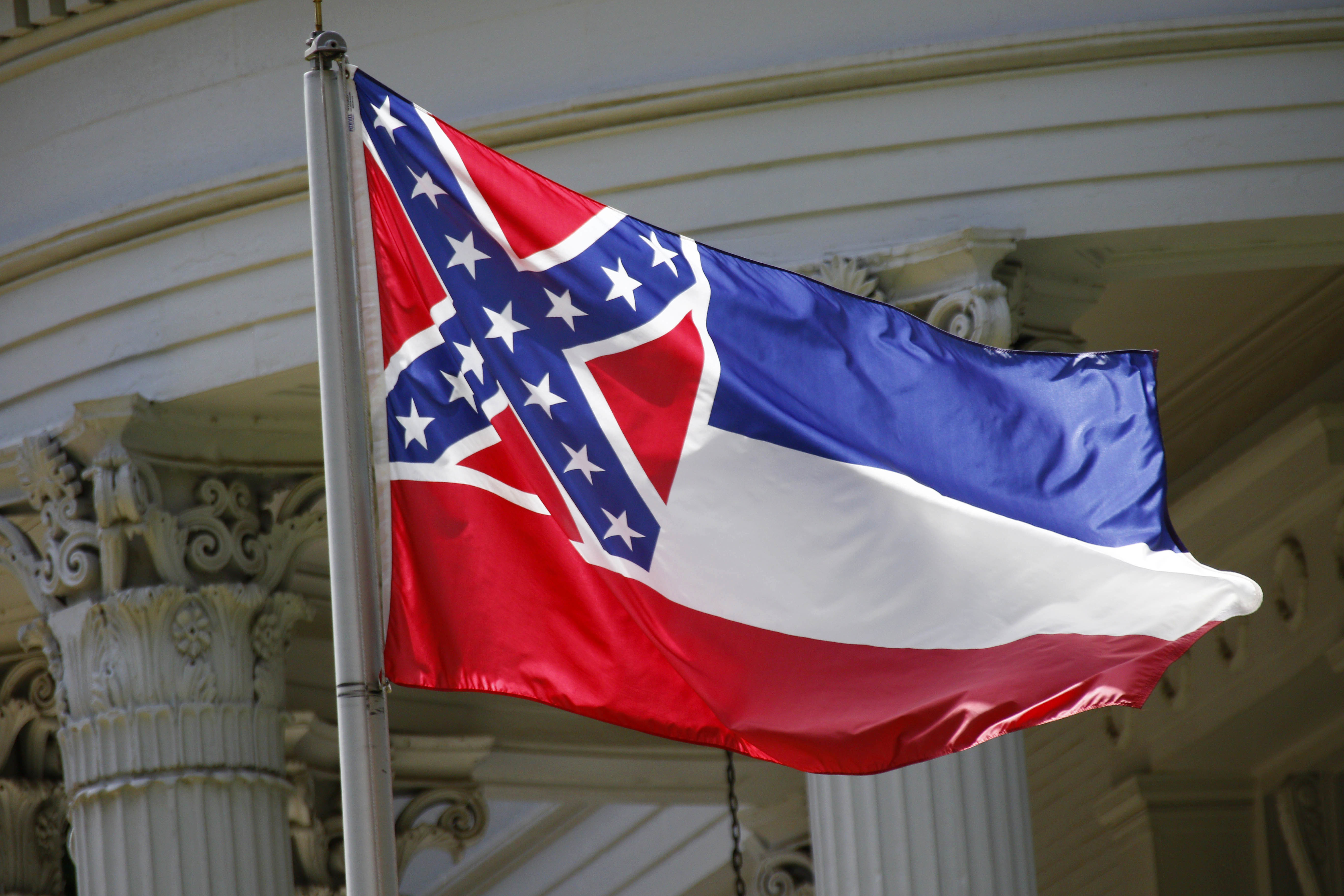 The state flag of Mississippi flies at the governor's mansion in Jackson on June 23, 2015.