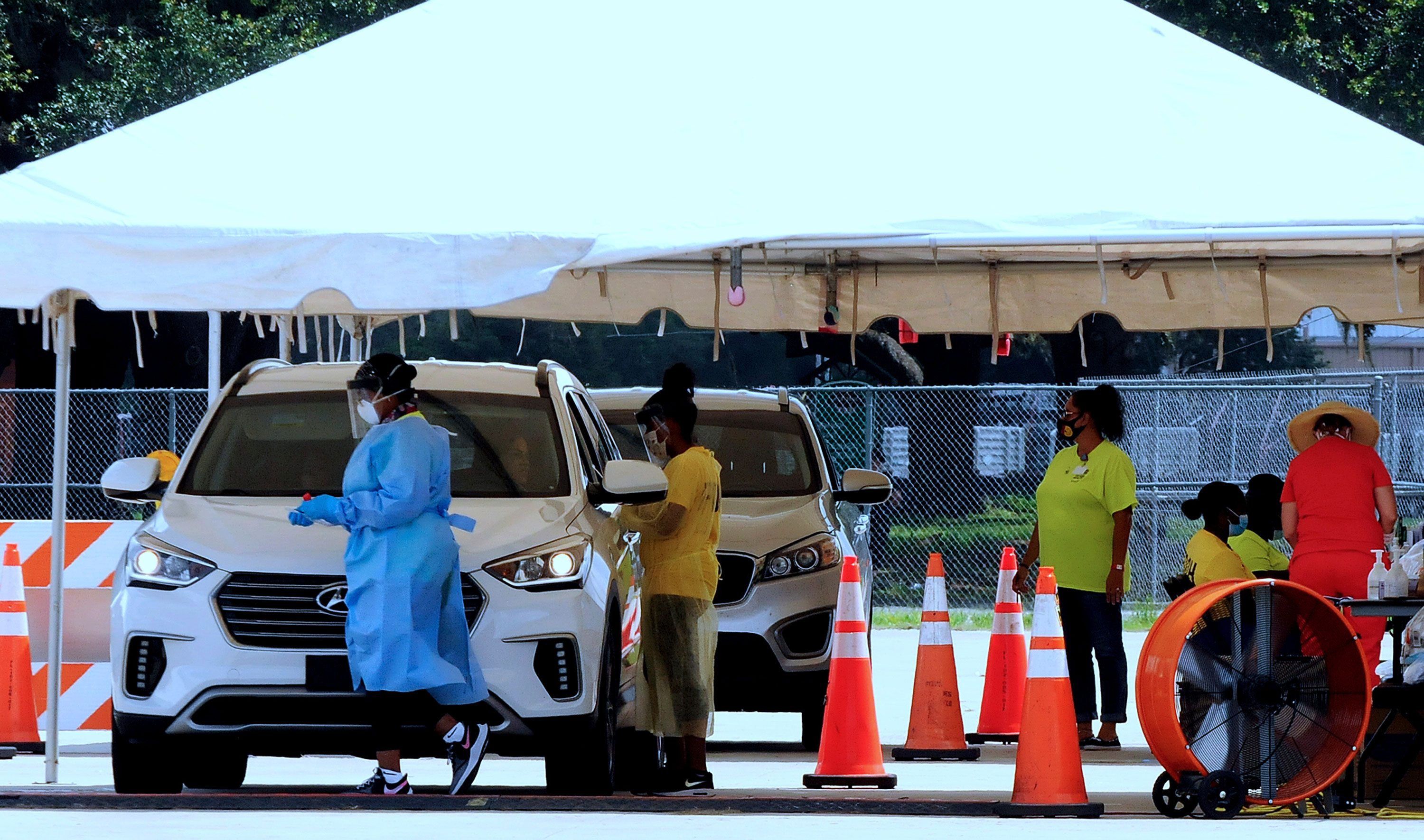 People are tested for Covid-19 at a drive-through testing site operated by the Florida Department of Health in Kissimmee, Florida, on July 11.