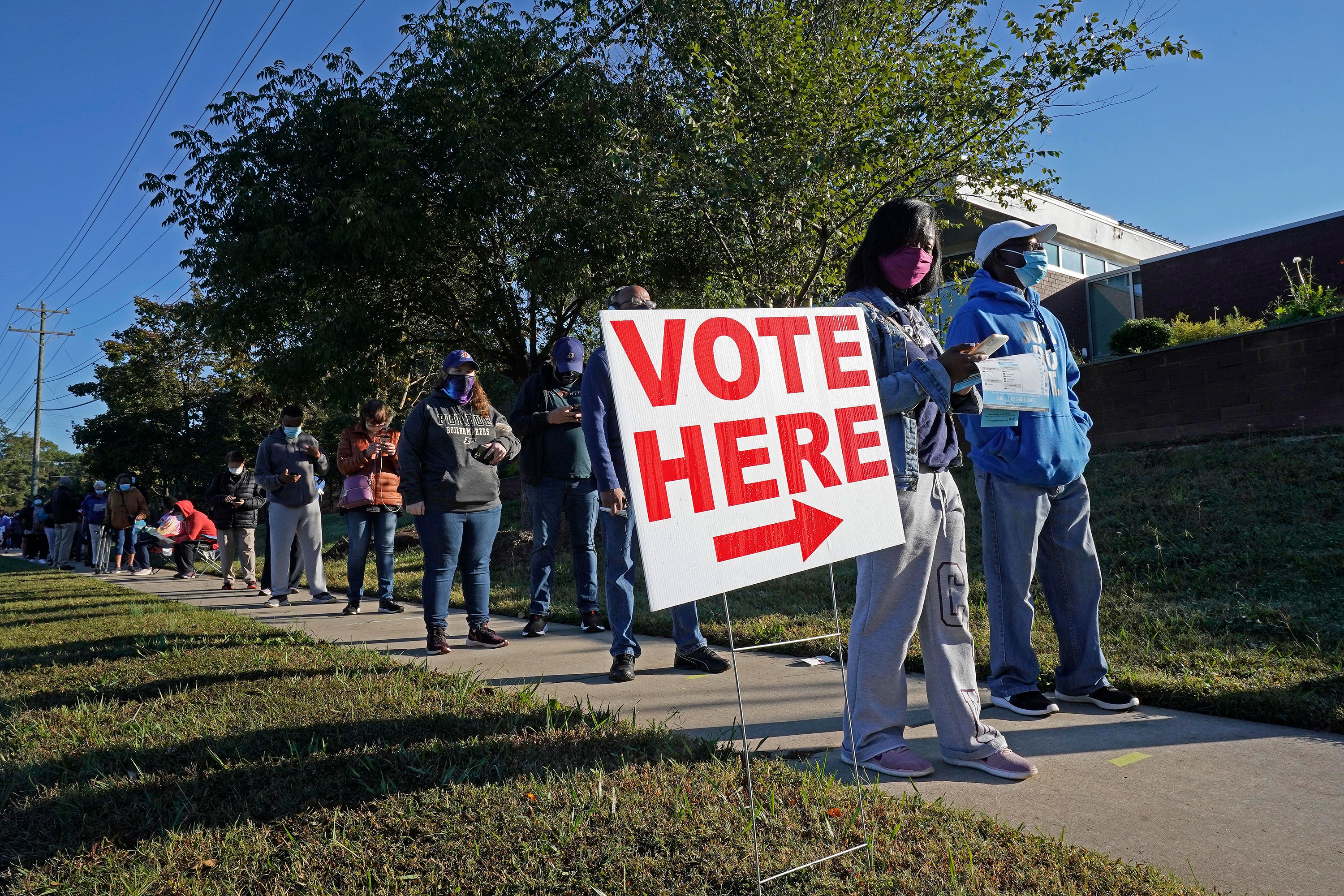 Early voters line up to cast their ballots at the South Regional Library polling location on October 15 in Durham, North Carolina.