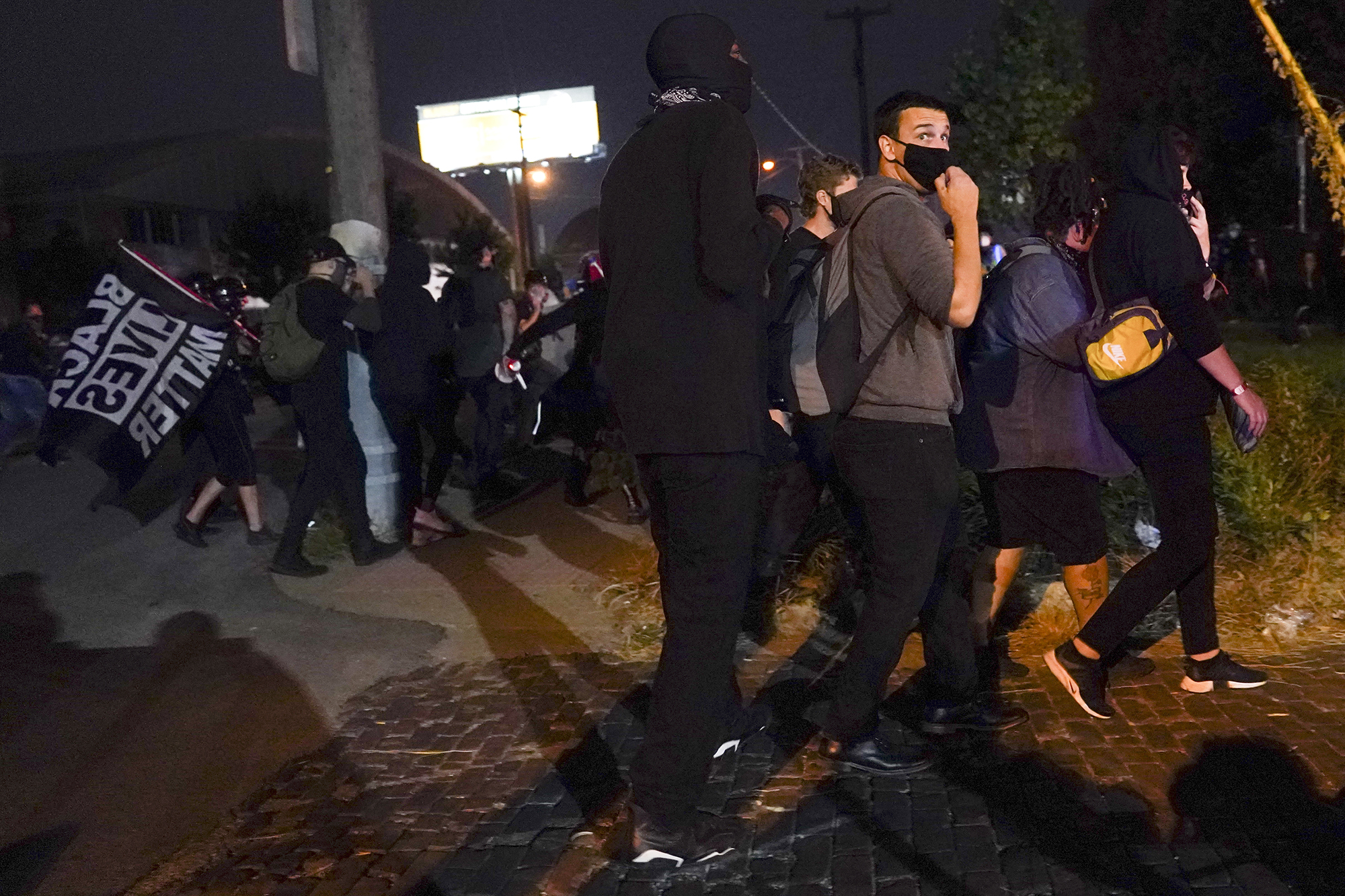 Protesters react to gunfire on Wednesday night in Louisville, Kentucky.