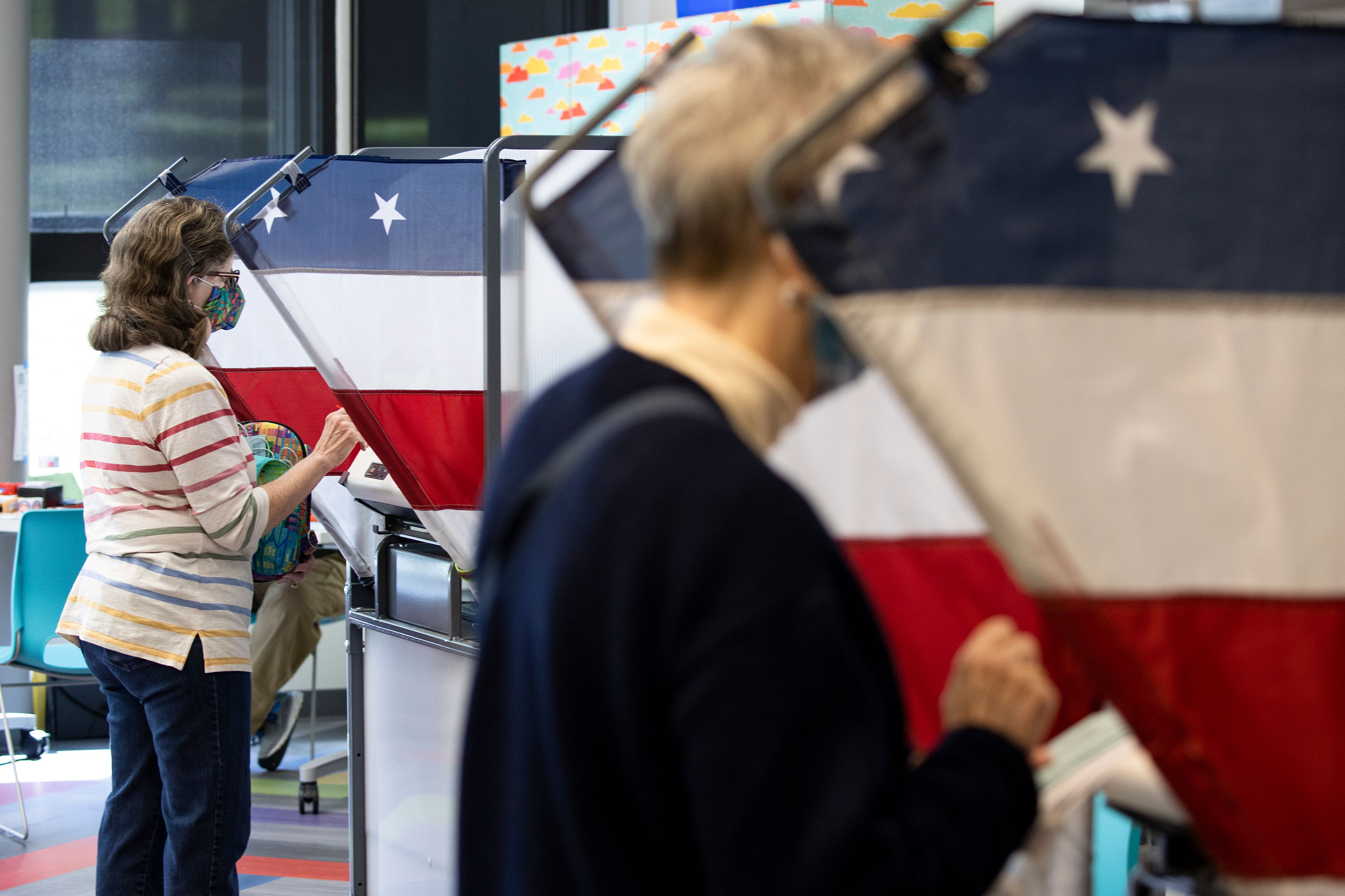 Voters cast their ballots during early voting on October 14 in Nashville, Tennessee.