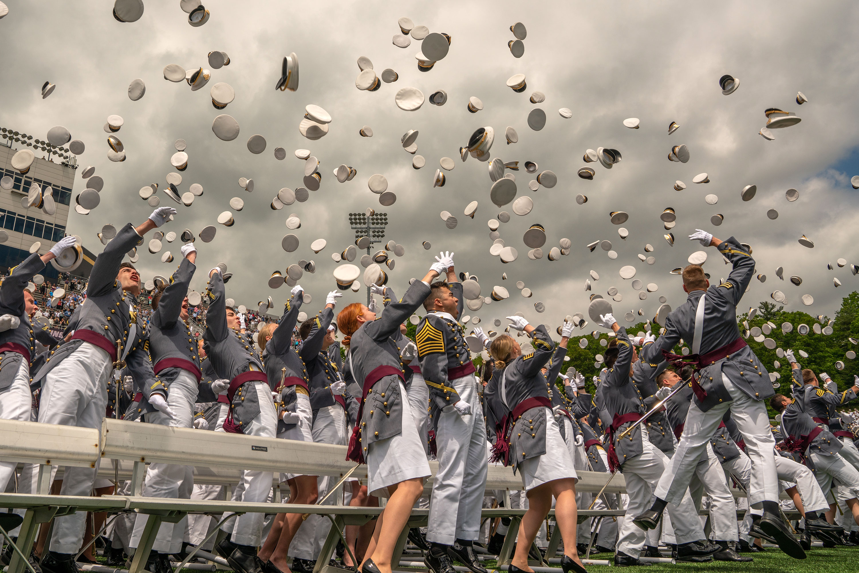 Graduates toss their hats in the air at the end of the US Military Academy Class of 2019 graduation ceremony on May 25, 2019, in West Point, New York.