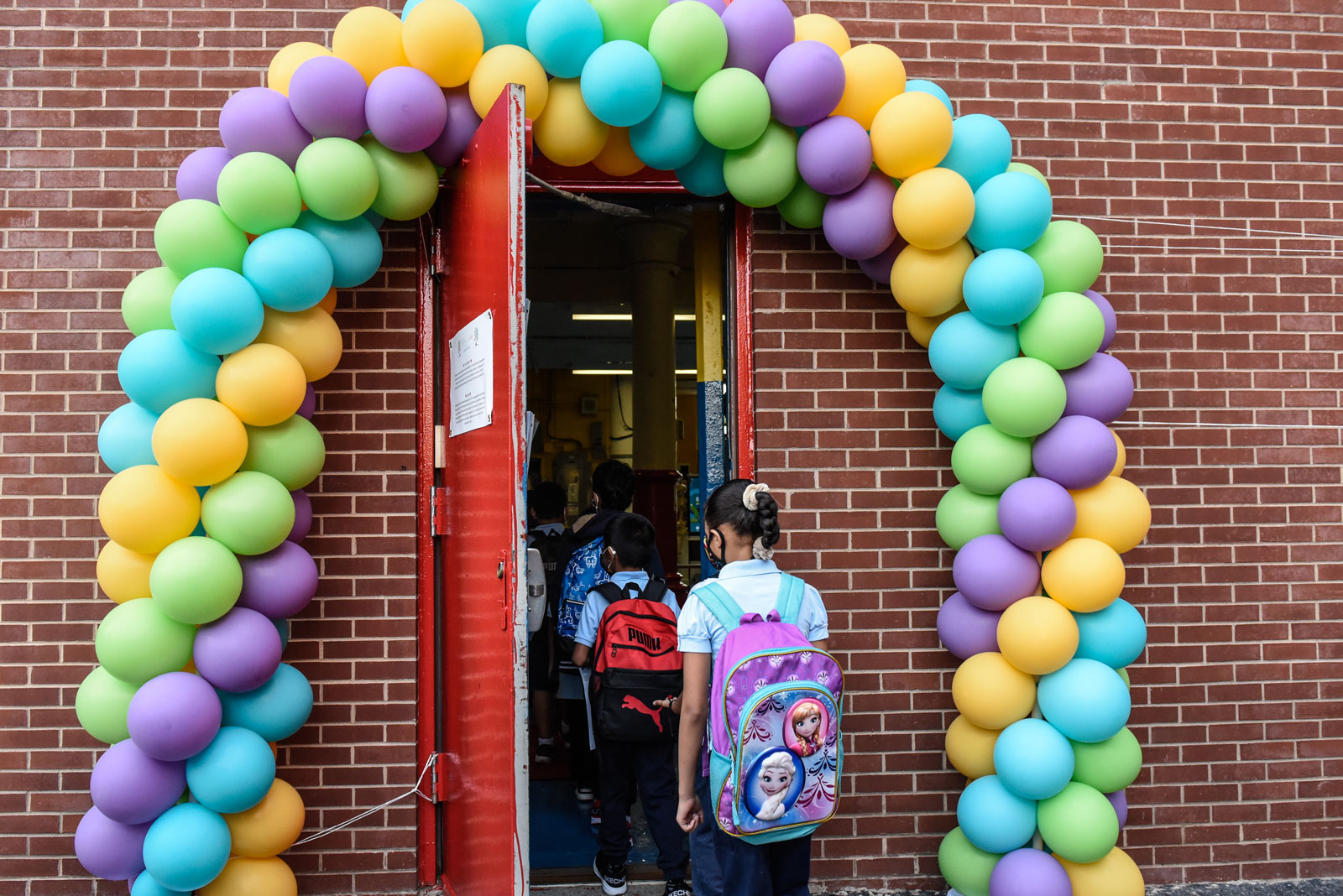 Students arrive on the first day of classes at a public school in the Bronx, New York on Sept. 13.
