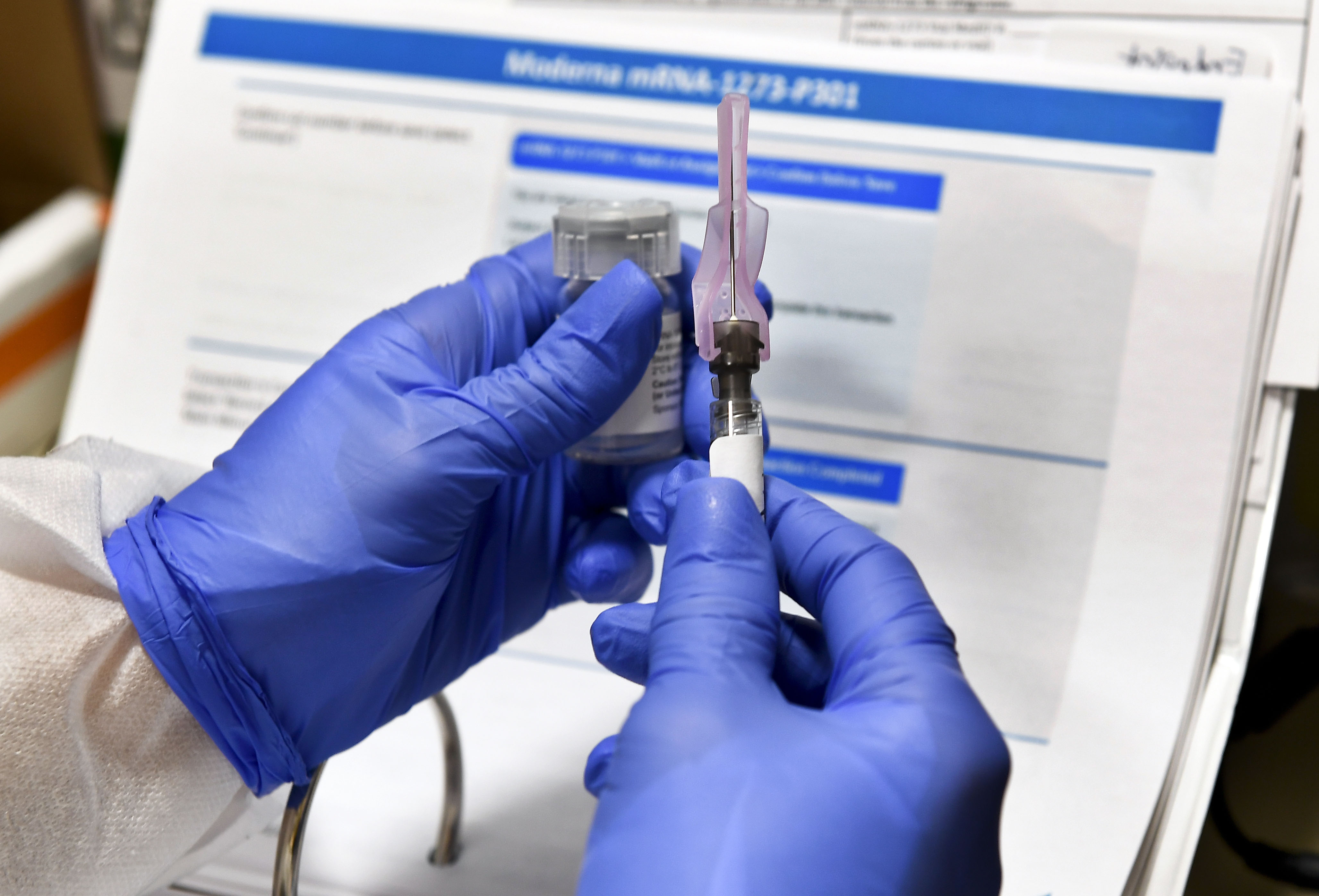 A nurse prepares a shot of a possible Covid-19 vaccine in Binghamton, New York, on July 27. The vaccine is developed by the National Institutes of Health and Moderna.