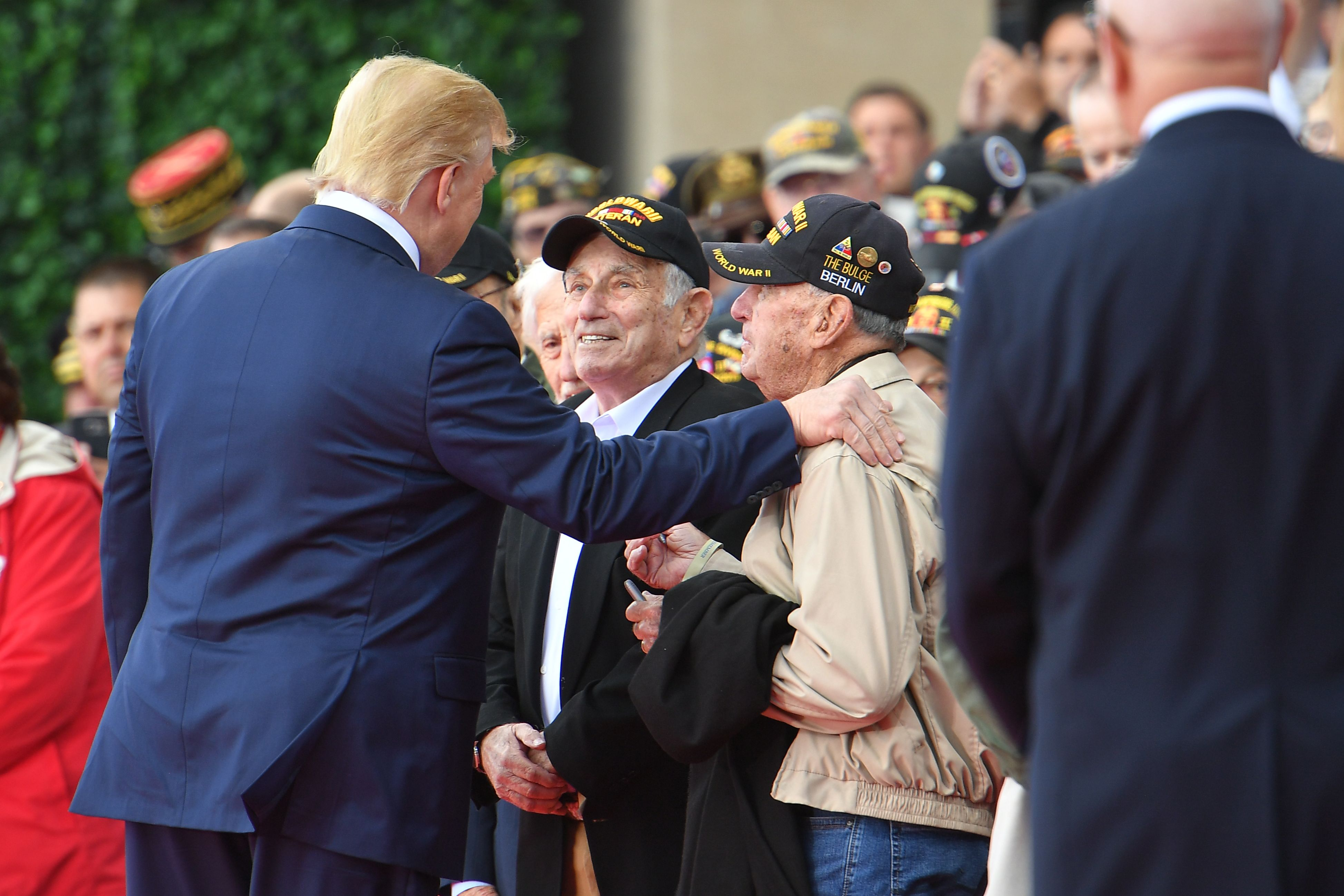 Donald Trump greets veterans before starting his speech.