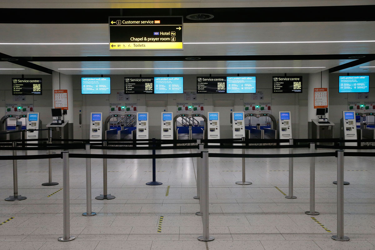 Self check-in machines are seen inside an empty Gatwick Airport on February 6 in London, England.