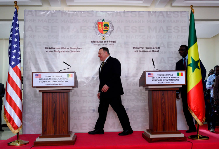 US Secretary of State Mike Pompeo (L) and Senegal's Foreign Affairs minister Amadou Ba arrive to hold a press conference at the Presidential Palace in Dakar on February 16.