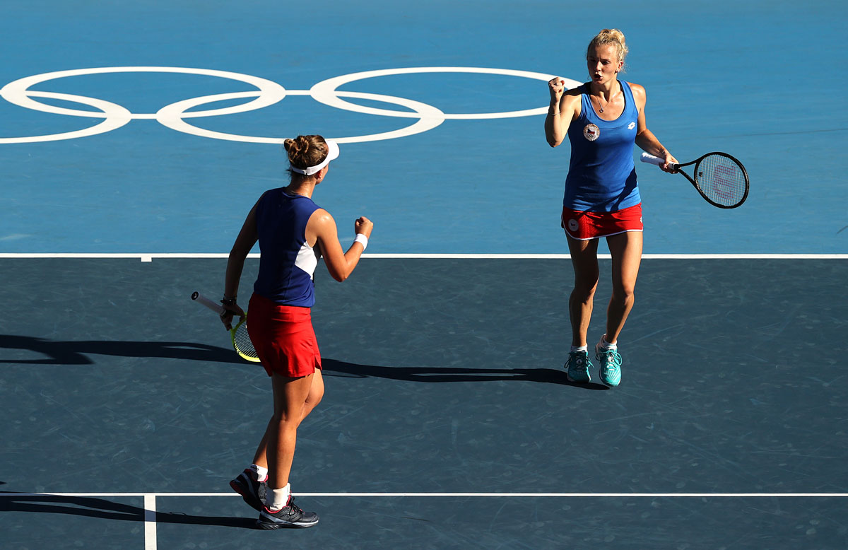 Barbora Krejcikova and Katerina Siniakova celebrate after a point during their Women's Doubles Gold Medal match against Belinda Bencic of Team Switzerland and Viktorija Golubic of Team Switzerland on day nine of the Tokyo 2020 Olympic Games at Ariake Tennis Park on August 01, 2021 in Tokyo, Japan. (Photo by Clive Brunskill/Getty Images)