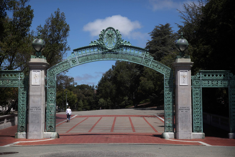 A lone pedestrian walks by Sather Gate on the U.C. Berkeley campus on July 22, 2020 in Berkeley, California.
