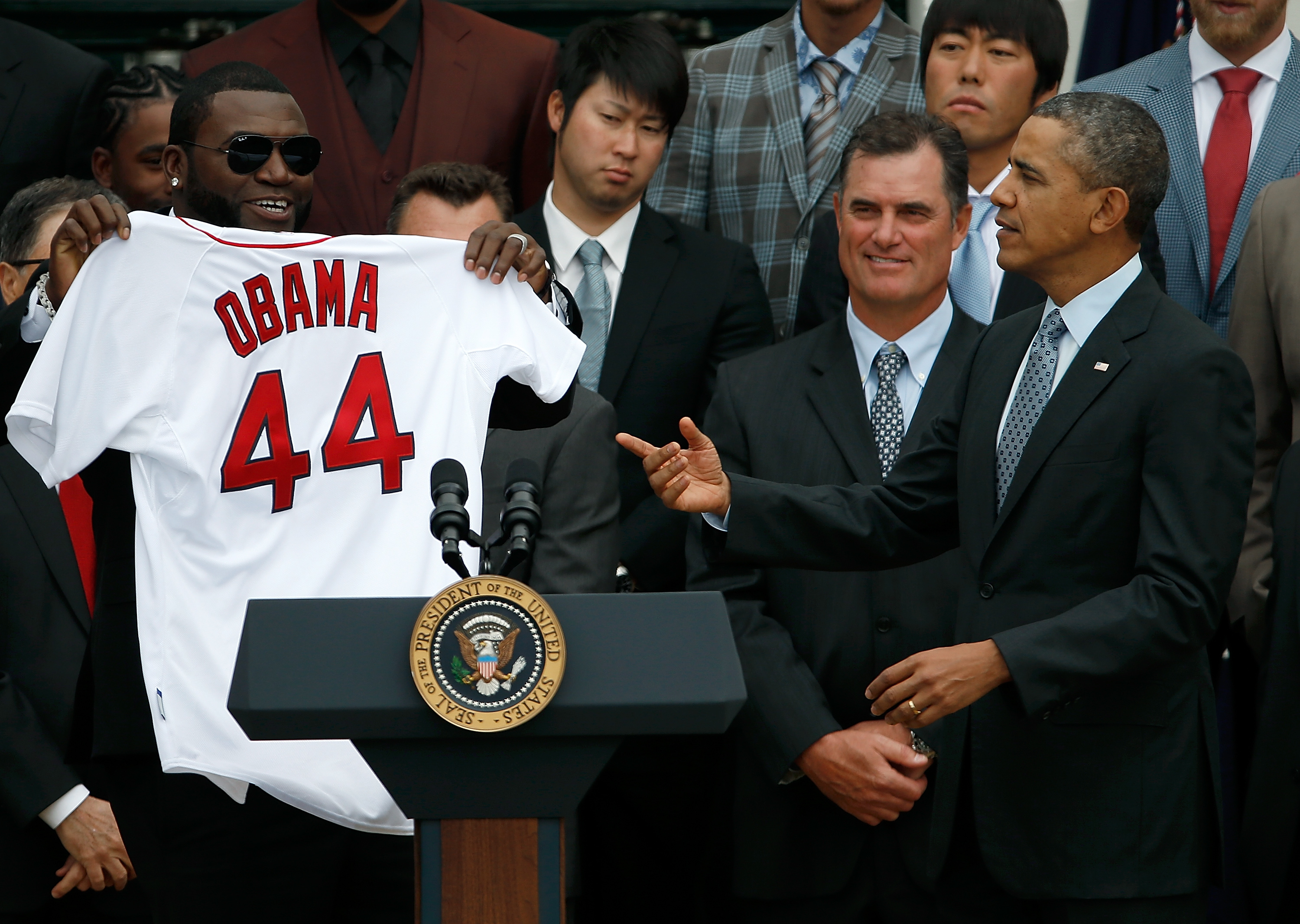 In this file photo, former Boston Red Sox designated hitter David Ortiz holds a Red Sox jersey presented to former US President Barack Obama during a ceremony at the White House on April 1, 2014 in Washington, DC.