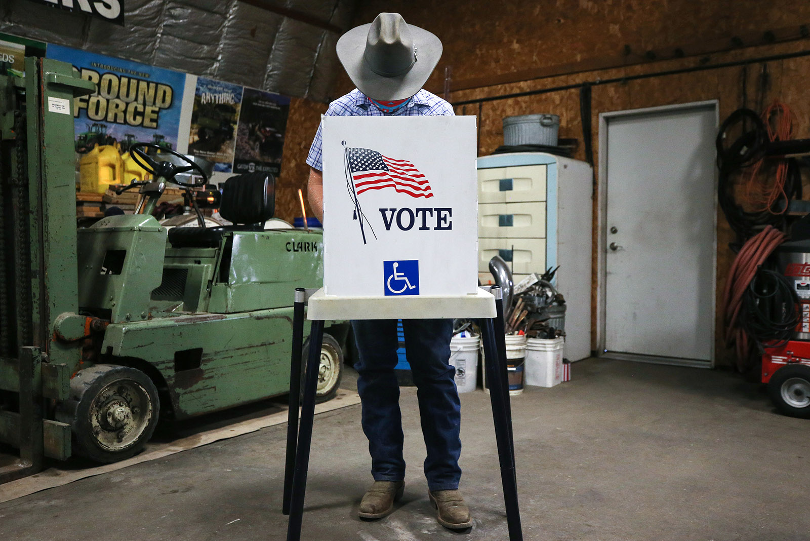 A voter marks his ballot at a polling place in Dennis Wilkening's shed on November 3, in Richland, Iowa.