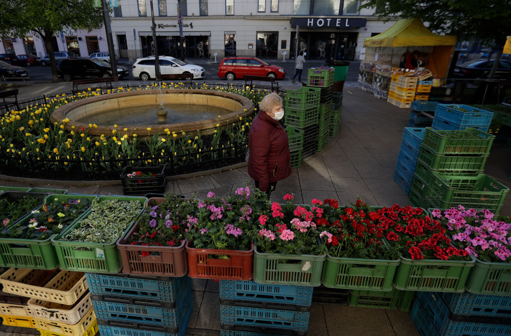 A woman shops at the recently-opened farmers' market in Prague on Monday, April 20.