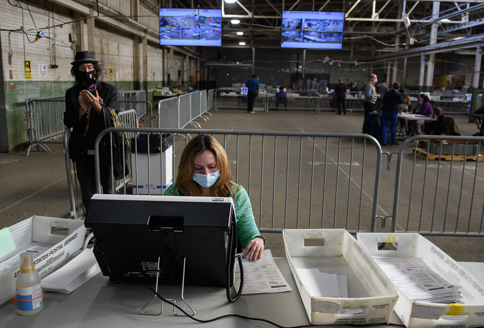 A Trump campaign poll watcher films the counting of ballots at the Allegheny County elections warehouse on November 6, in Pittsburgh, Pennsylvania.