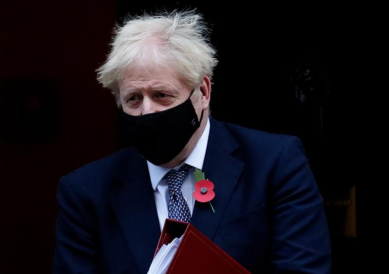 Boris Johnson leaves 10 Downing Street on Wednesday.