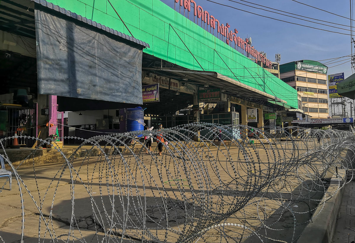 A shrimp market in Samut Sakhon, Thailand is closed and surrounded with barbed wire on December 20.