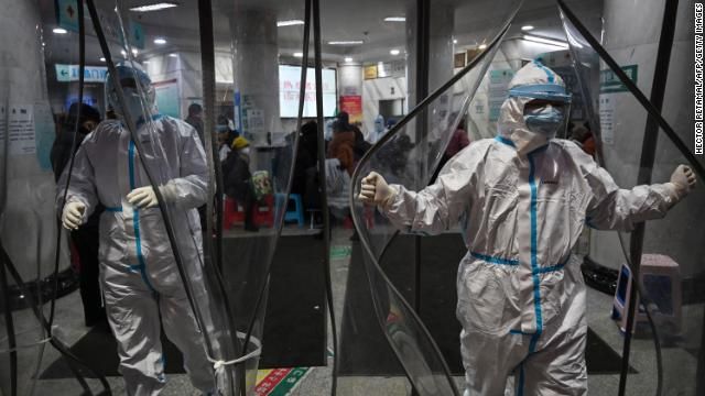 Medical staff members wearing protective clothing in Wuhan.