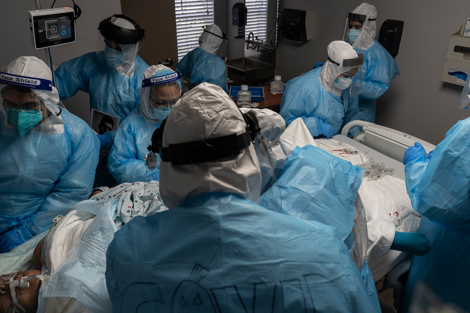 Medical staff members treat a patient suffering from Covid-19 at the United Memorial Medical Center (UMMC), in Houston, on October 31.