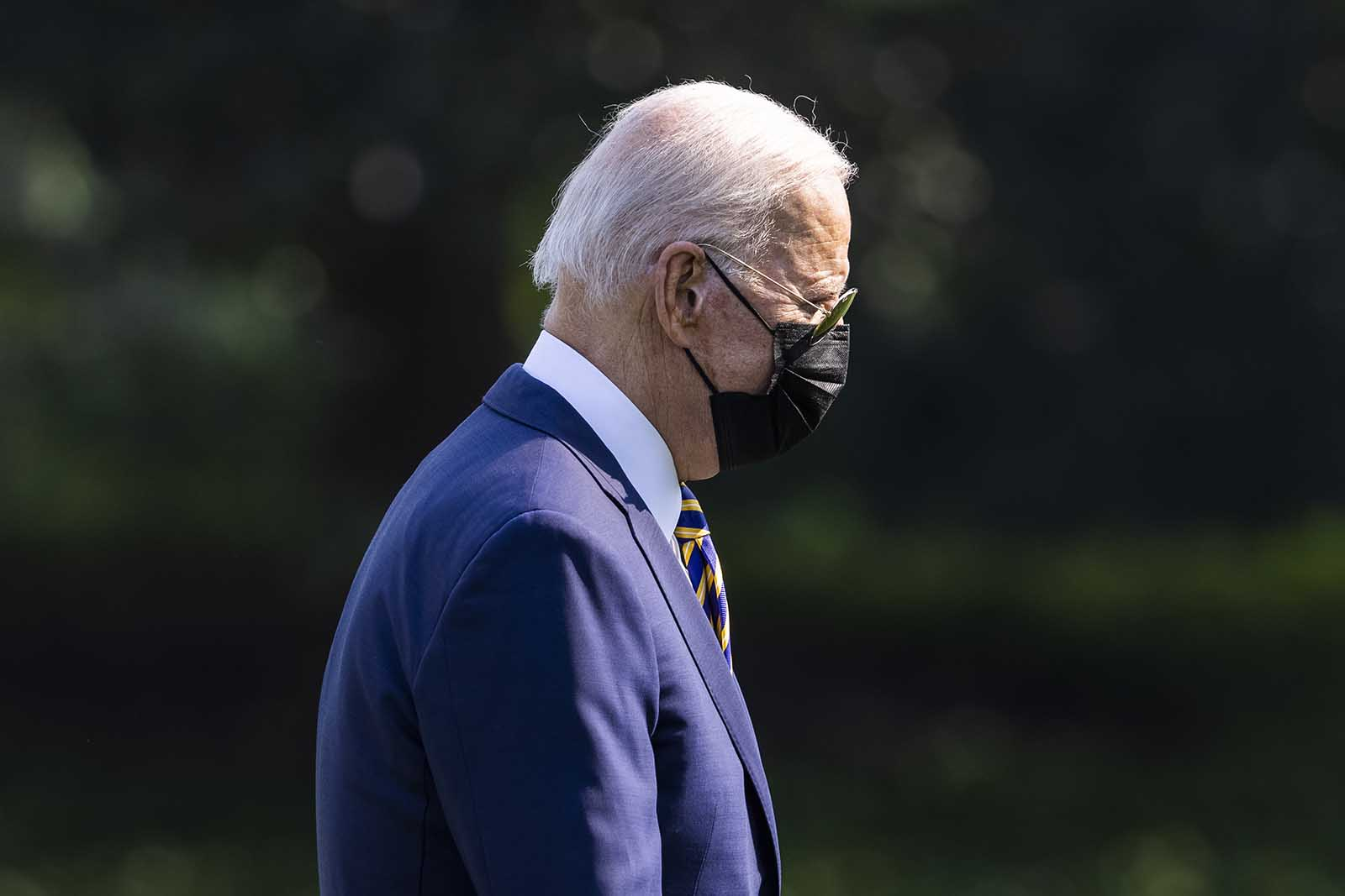 President Joe Biden walks on the South Lawn of the White House in Washington, DC on Wednesday, July 28.