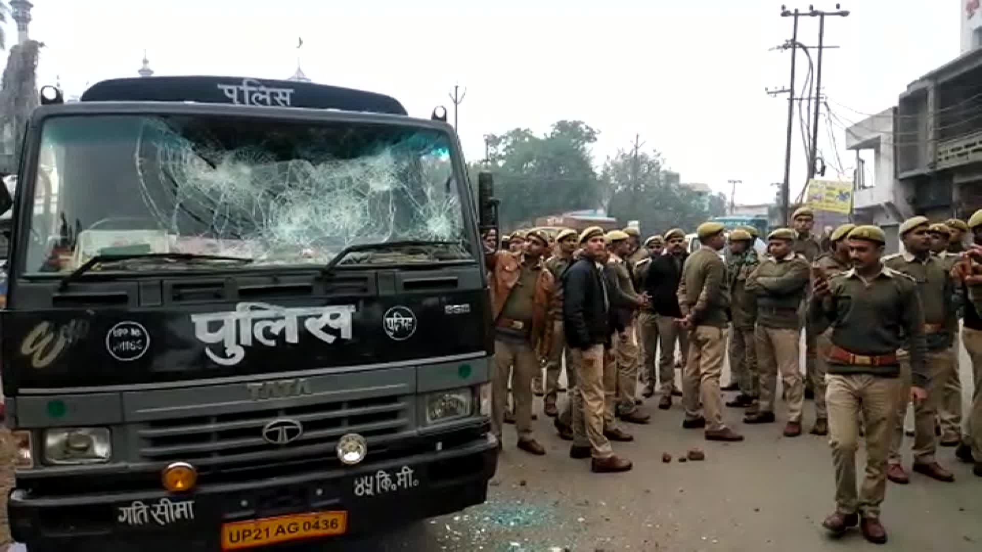 A damaged vehicle is seen in Sambhal.