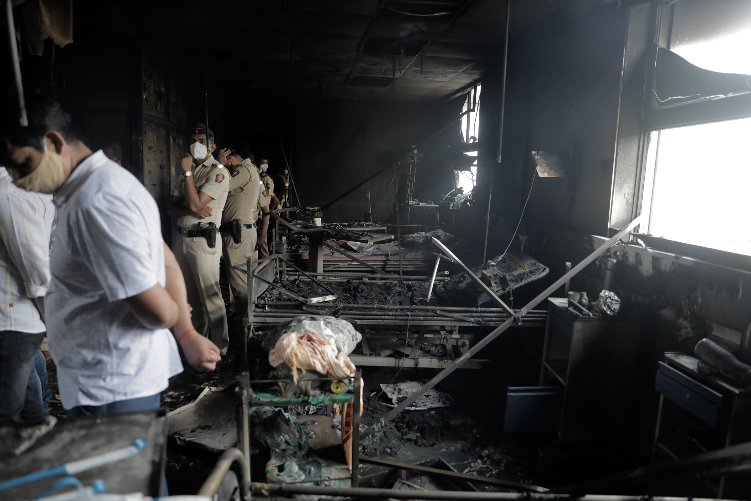 People inspect an ICU ward after a fire broke out in Vijay Vallabh Covid-19 hospital at Virar, near Mumbai, India, on Friday, April 23.