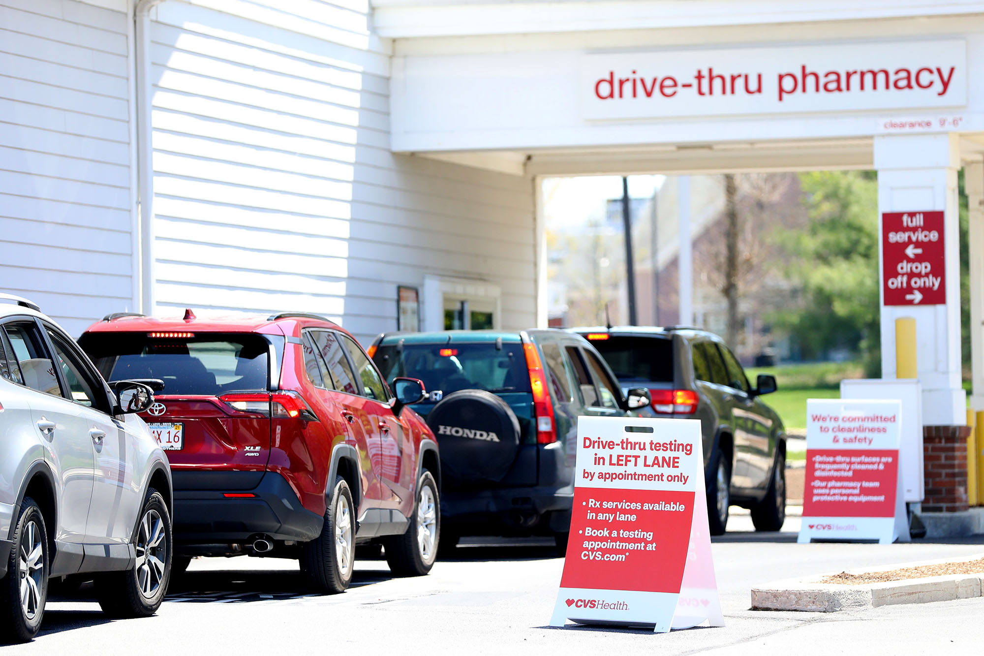 Cars line up for a drive-thru coronavirus test at CVS Pharmacy on May 15, in Carver, Massachusetts.