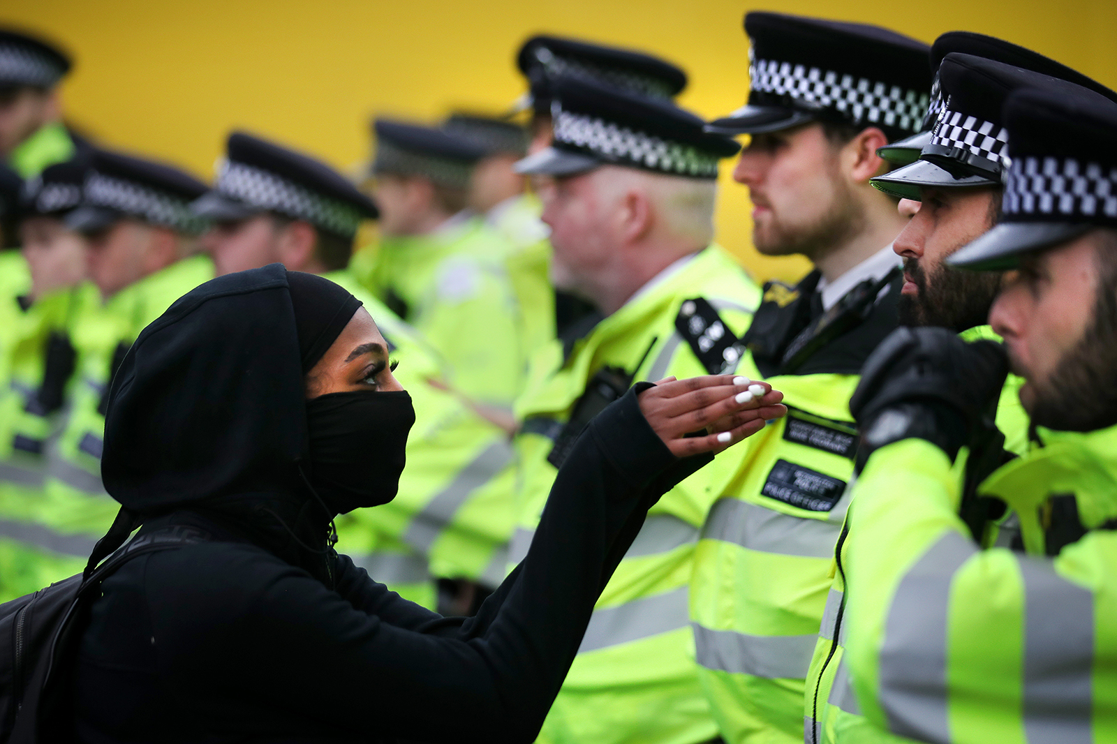A protester confronts a police officer during a Black Lives Matter protest on June 6, in London.