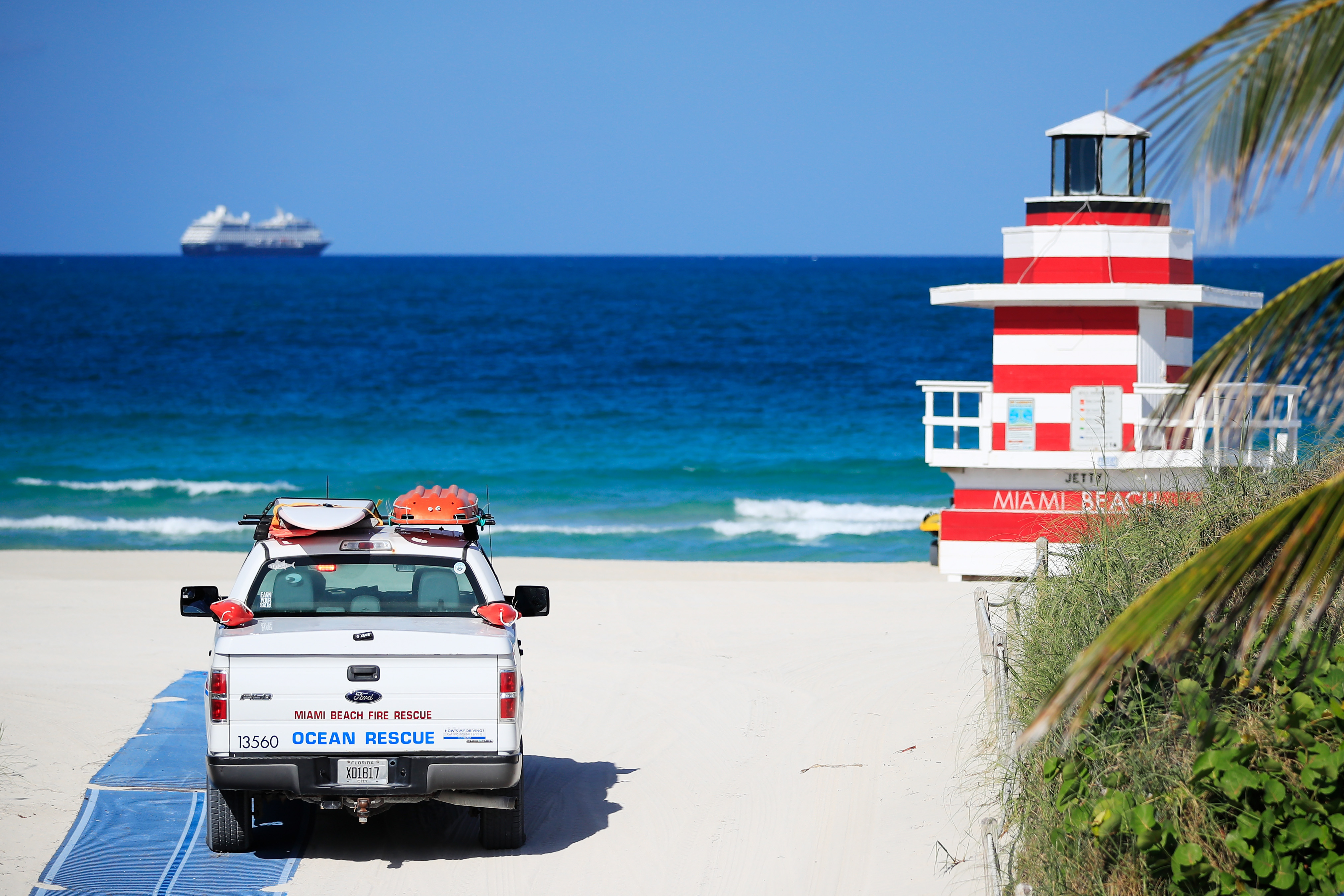 A Miami Beach Fire Rescue vehicle drives onto the beach in South Pointe in Miami Beach, Florida on April 29.