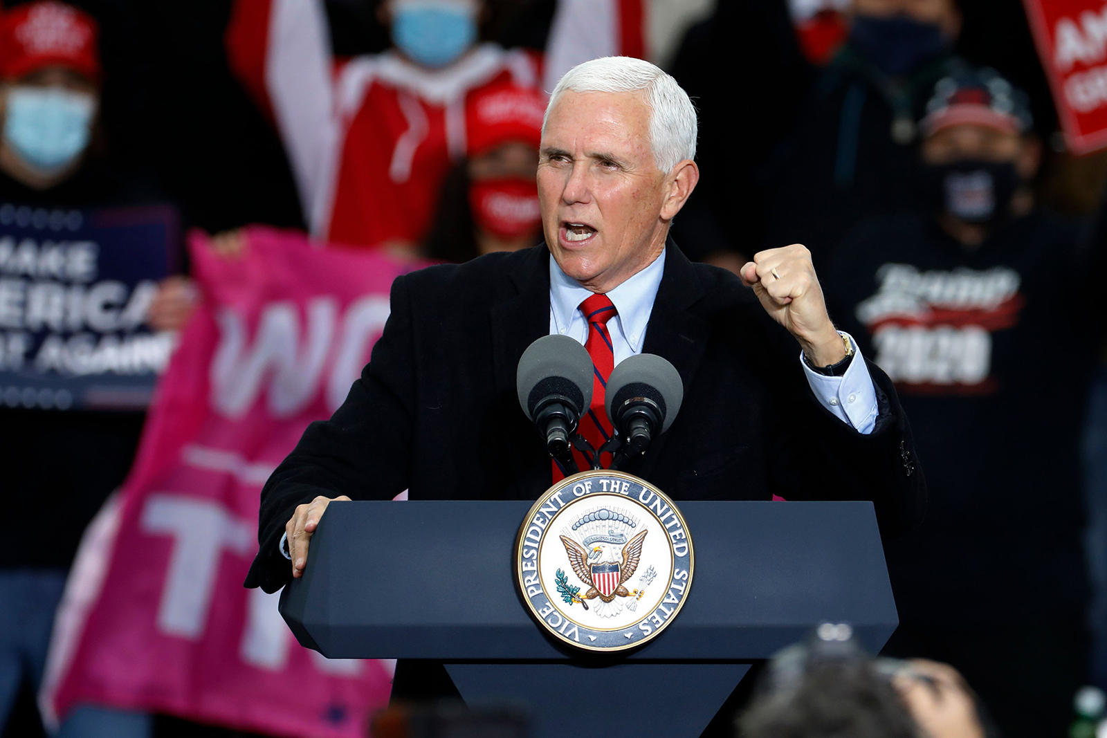 "US Vice President Mike Pence speaks during a ""Make America Great Again!"" campaign event at Oakland County International Airport in Waterford, Michigan, on October 22."