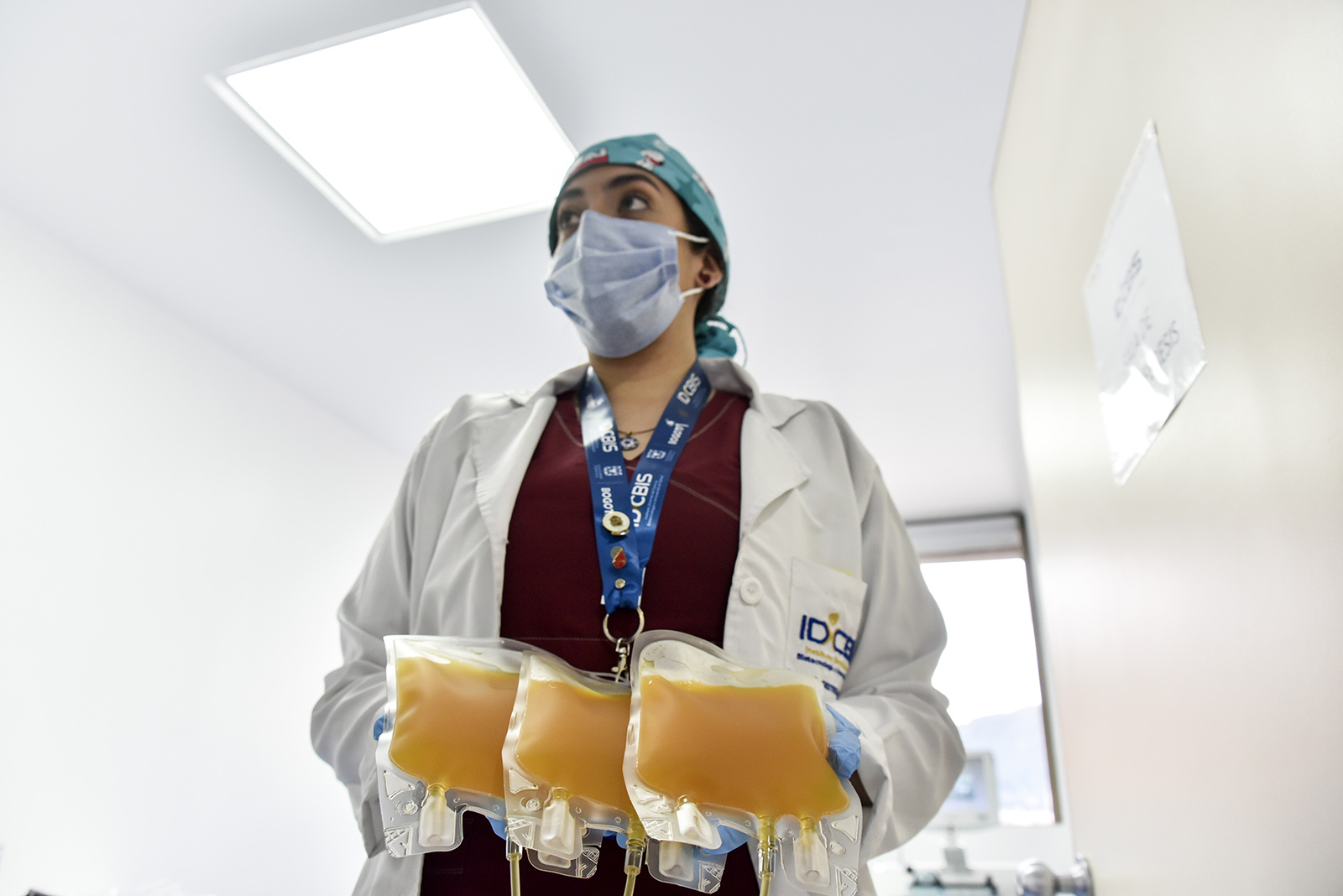 Nurse Lina Acevedo holds the plasma donated by a man who recovered from COVID-19 on August 14 in Bogota, Colombia.