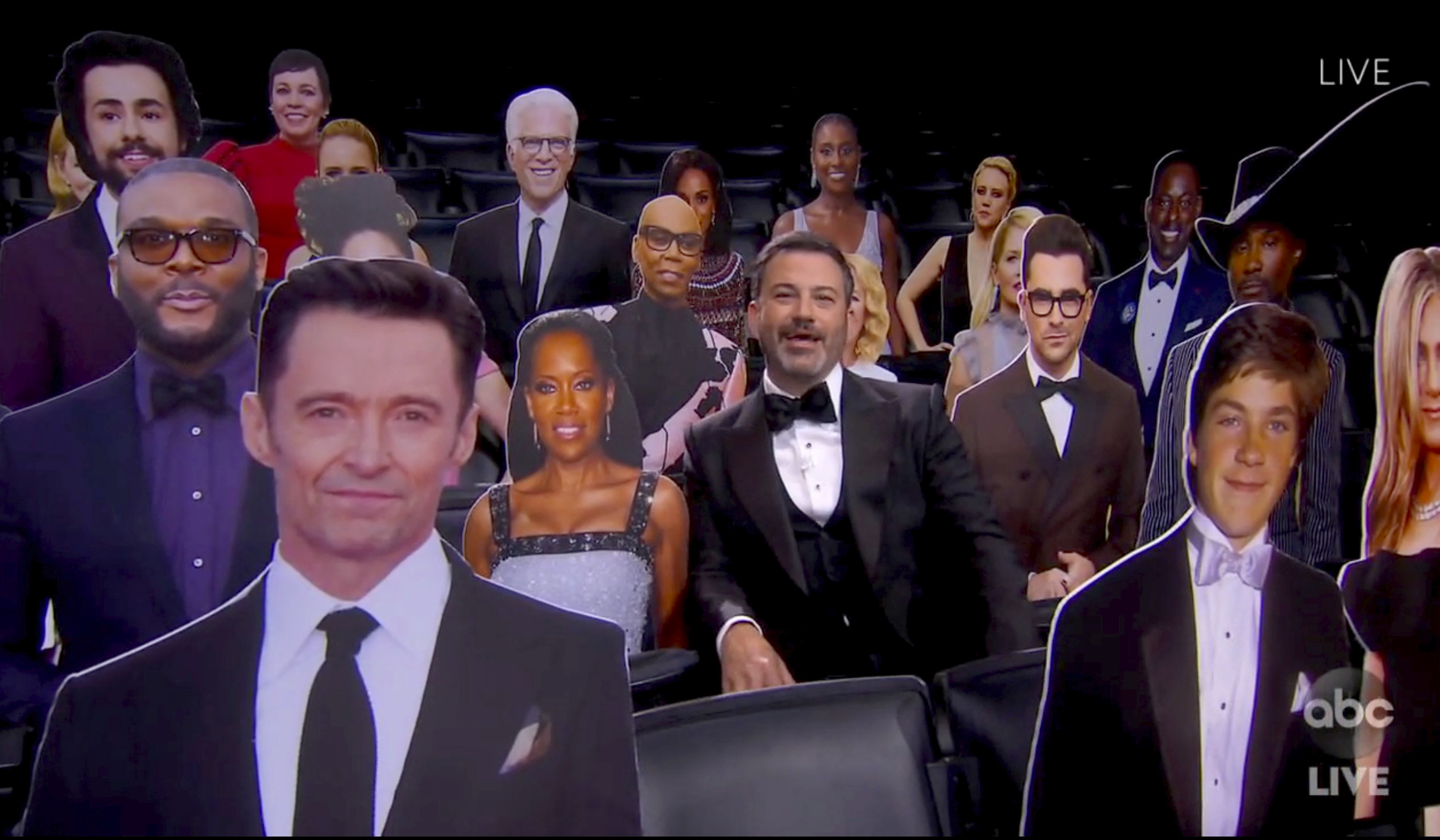 In this video grab captured on Sept. 20, 2020, courtesy of the Academy of Television Arts & Sciences and ABC Entertainment, host Jimmy Kimmel speaks surrounded by cardboard cutouts of actors in the audience during the 72nd Emmy Awards broadcast.