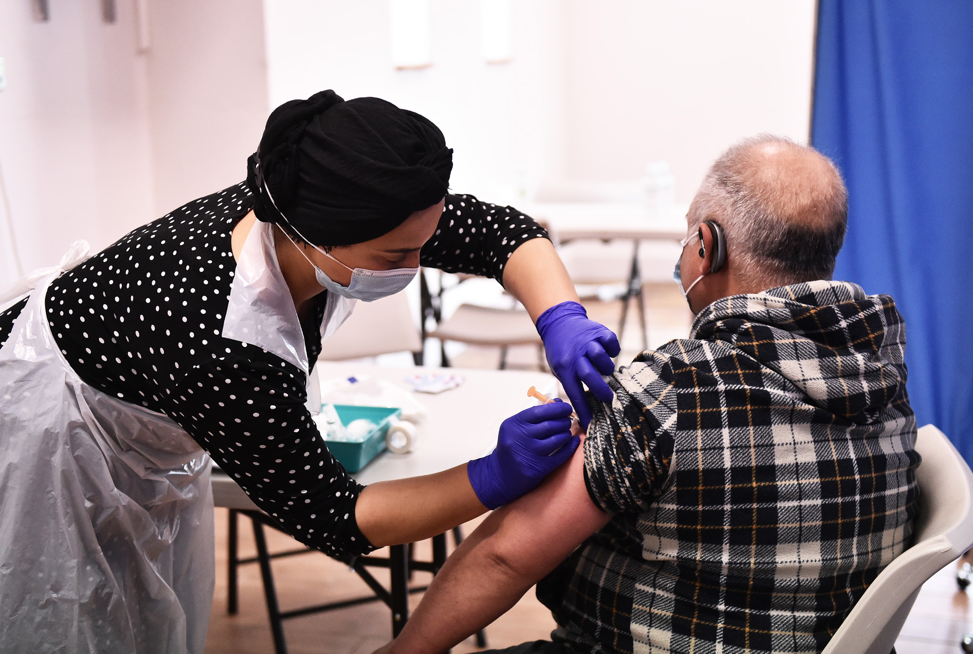 Sonia Akbar prepares to administers the AstraZeneca/Oxford Covid-19 vaccine to a patient at a pop up vaccination centre at the Pakistani Community Centre on April 9 in Derby, England.