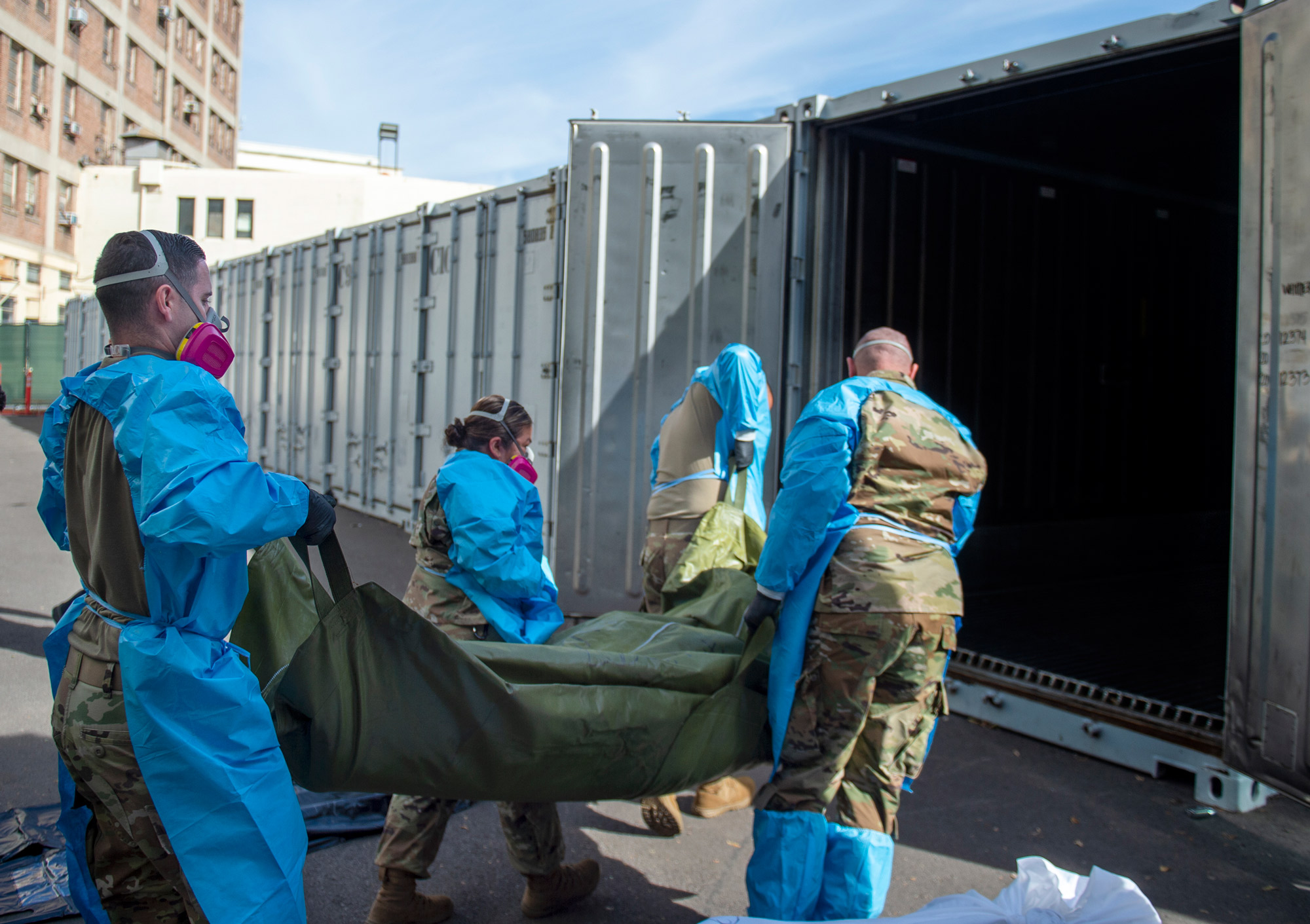 Members of the National Guard assist with processing Covid-19 deaths and placing them into temporary storage at LA County Medical Examiner-Coroner Office in Los Angeles on January 12 in Los Angeles.