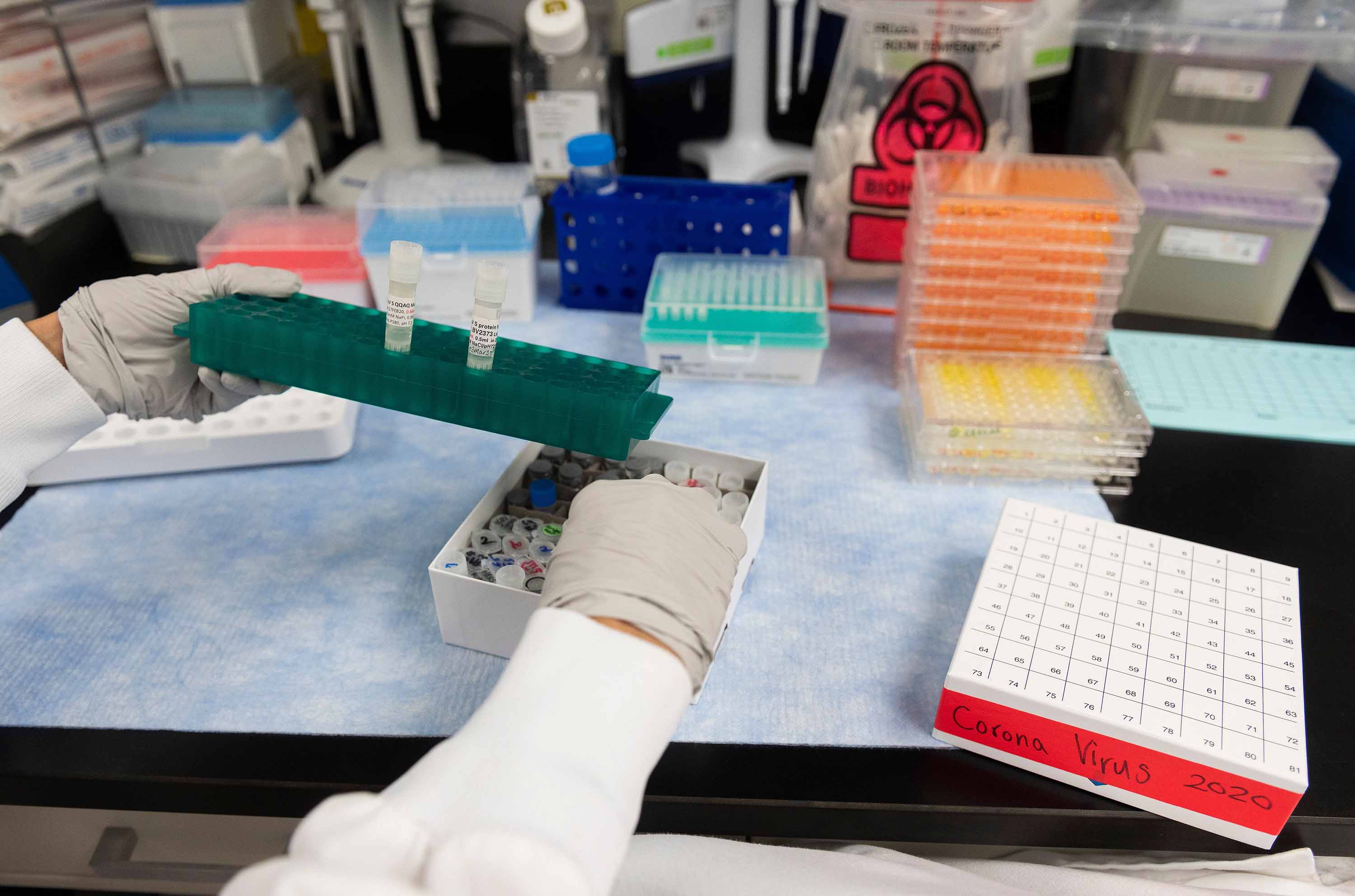 A researcher works on coronavirus vaccine development at Novavax labs in Gaithersburg, Maryland on March 20.