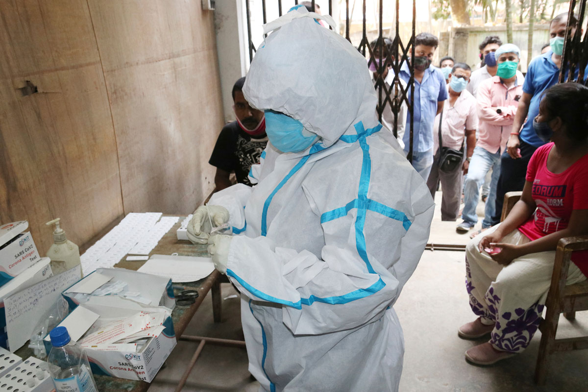 Health care workers test for Covid-19 at North 24 Parganas district in West Bengal, India on May 8.