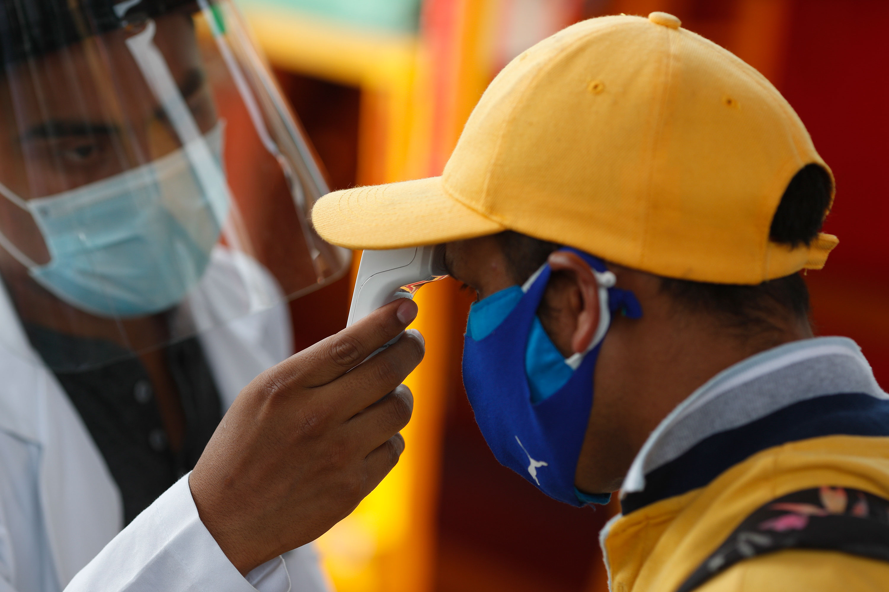 A worker gets his temperature taken prior to being tested for Covid-19 in Mexico City, on Thursday, September 10.