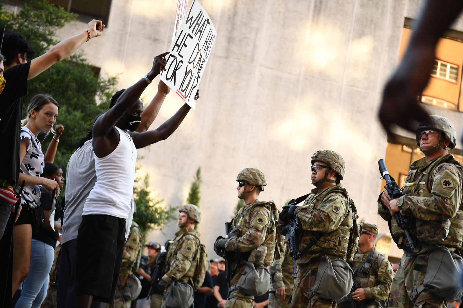 """National Guards form a line in front of """"Black Lives Matter"""" protestors in Tulsa, Oklahoma where Donald Trump holds a campaign rally at the BOK Center on June 20."""